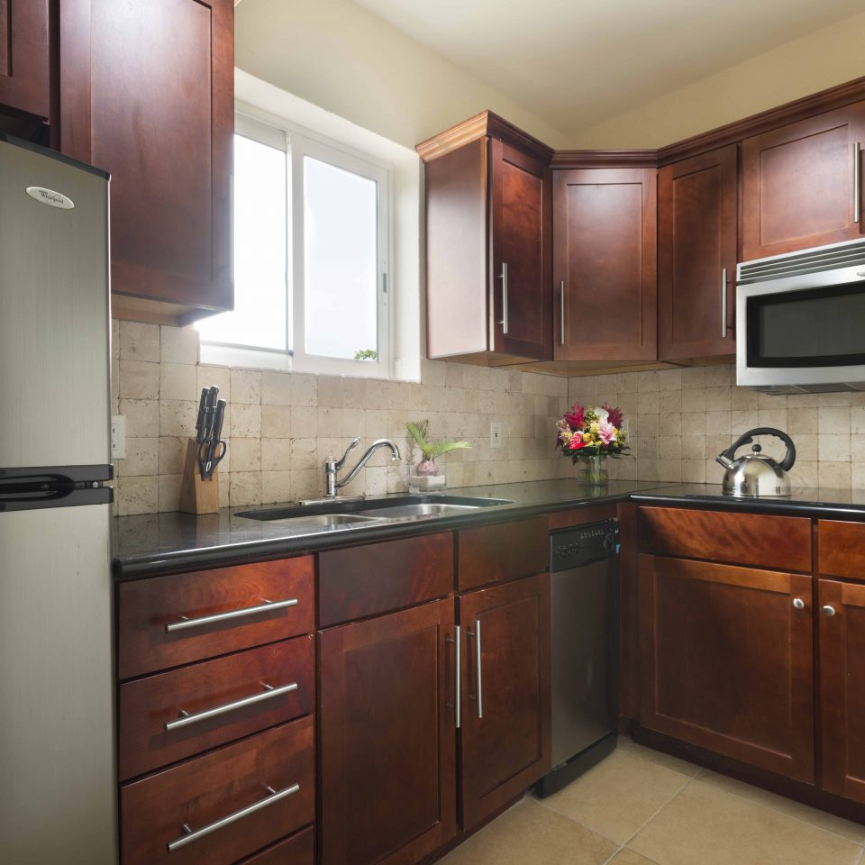 Interior of kitchen with dark mahogany cabinets