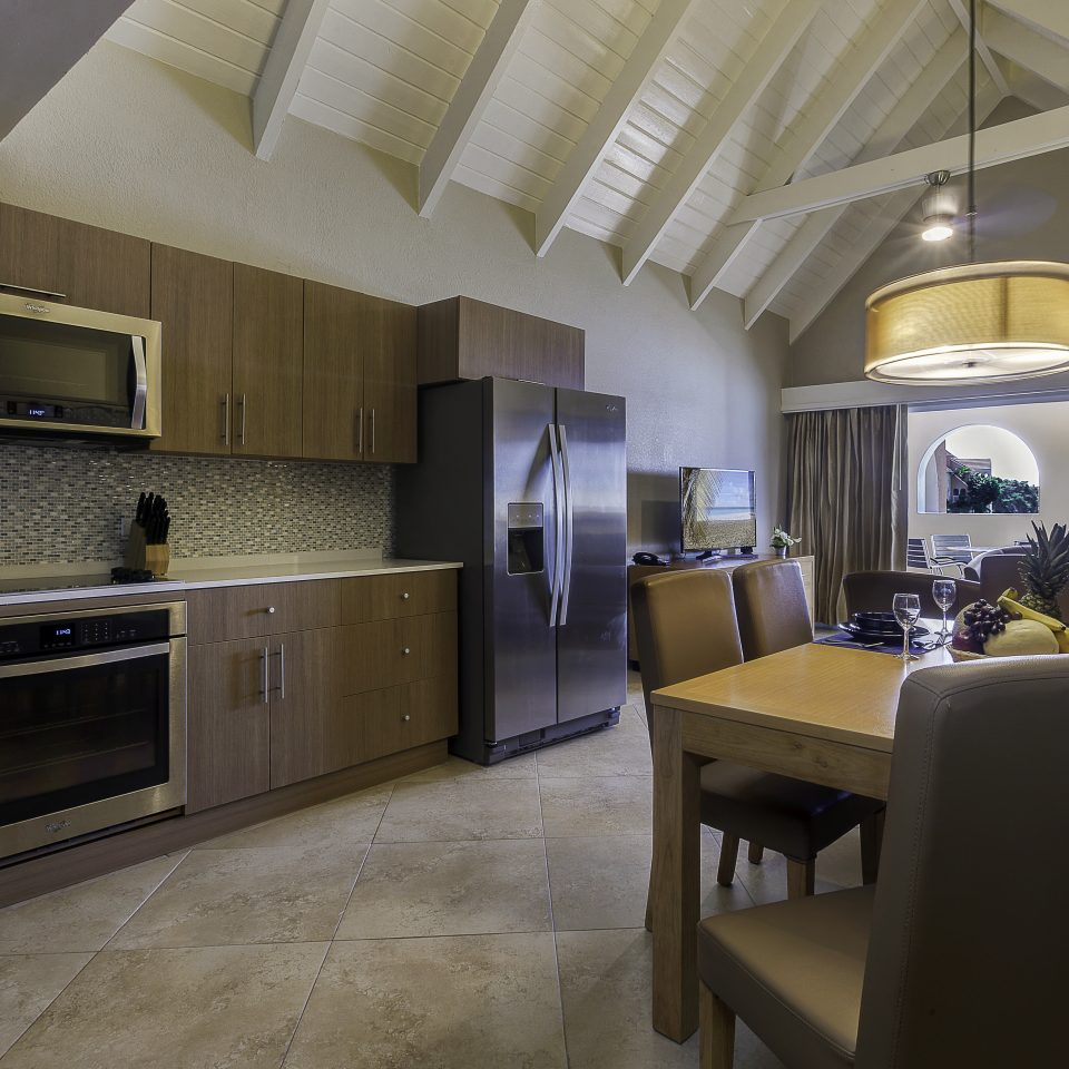 Suite interior with kitchen, dining area, and view of back living space