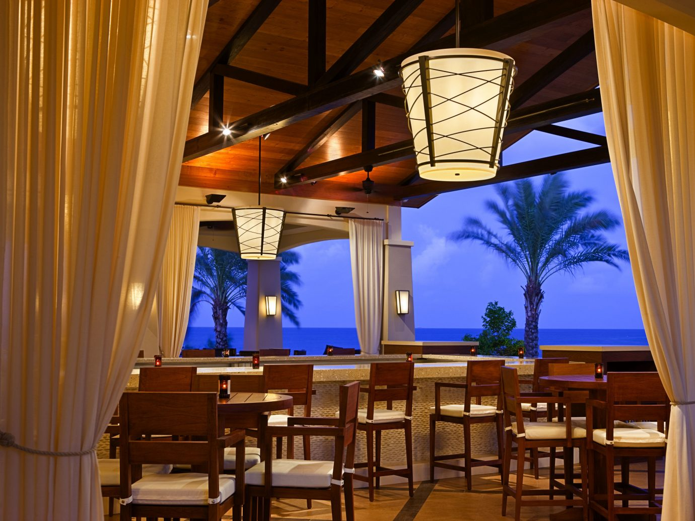All-Inclusive Resorts Hotels indoor chair curtain restaurant interior design lighting dining room ceiling real estate table café furniture