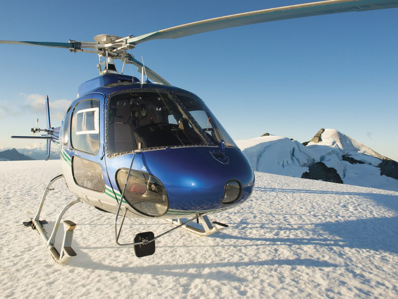 helicopter Hotels isolation Luxury Travel Mountains remote snow transportation Winter sky outdoor vehicle helicopter rotor rotorcraft aircraft transport atmosphere of earth aviation military helicopter flight autogiro
