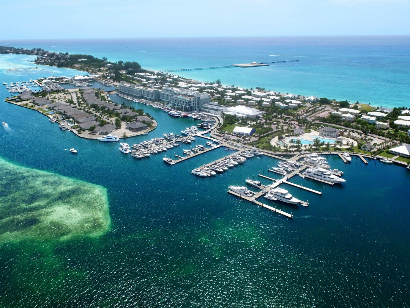 Hotels water sky Nature outdoor Ocean Coast Sea reef aerial photography marina horizon bay port dock channel cape shore caribbean archipelago islet promontory Island overlooking