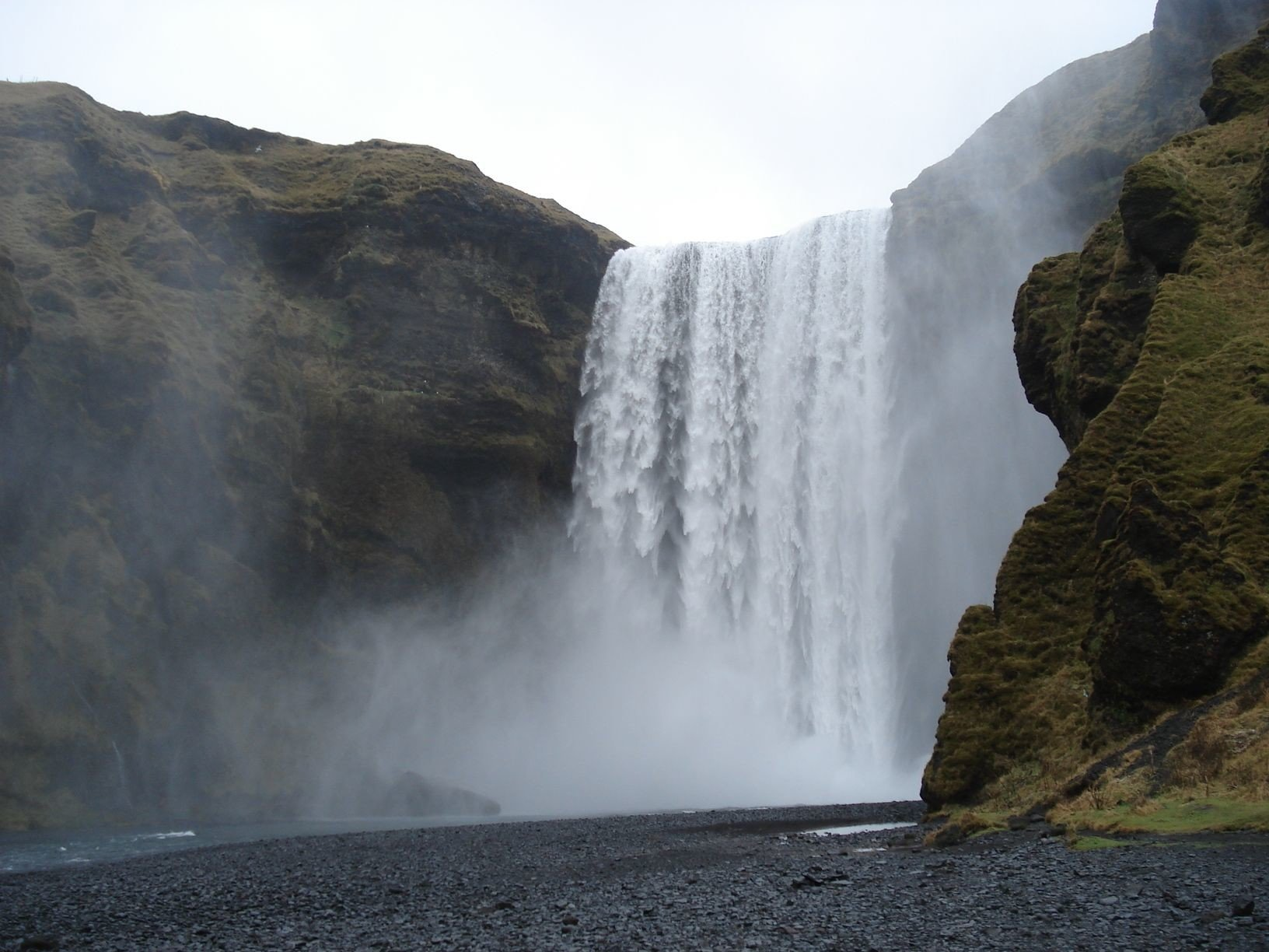 Iceland Outdoors + Adventure mountain Nature outdoor Waterfall rock body of water atmospheric phenomenon water water feature Coast cliff Sea wasserfall terrain fjord