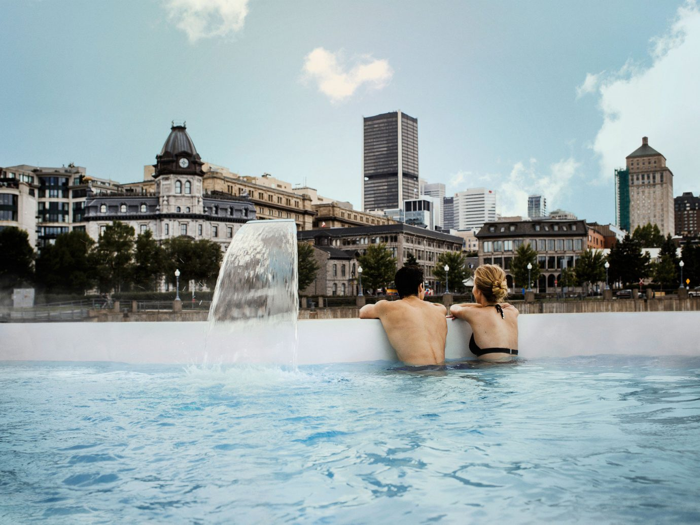 City city views couple Hot tub Hot tub/Jacuzzi jacuzzi outdoor pool Outdoors people Pool relaxation relaxing Spa Trip Ideas view water outdoor sky swimming pool fountain landmark vacation amusement park water feature tourism Water park park Sea Resort swimming