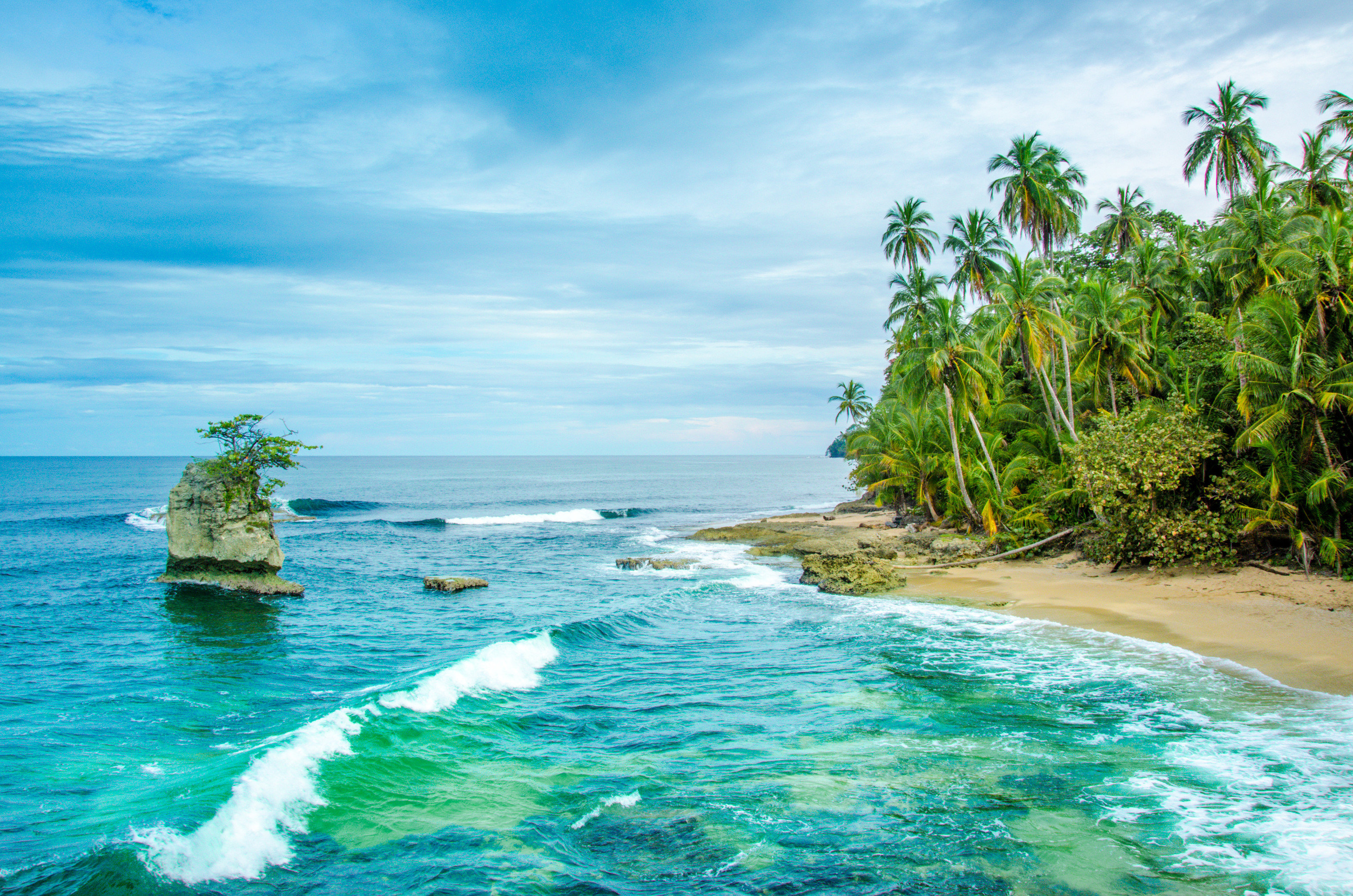 Hotels Trip Ideas water outdoor sky Sea tropics coastal and oceanic landforms Ocean Coast caribbean shore promontory Island Nature islet arecales palm tree bay Lagoon tree vacation Beach tourism wave computer wallpaper cove day
