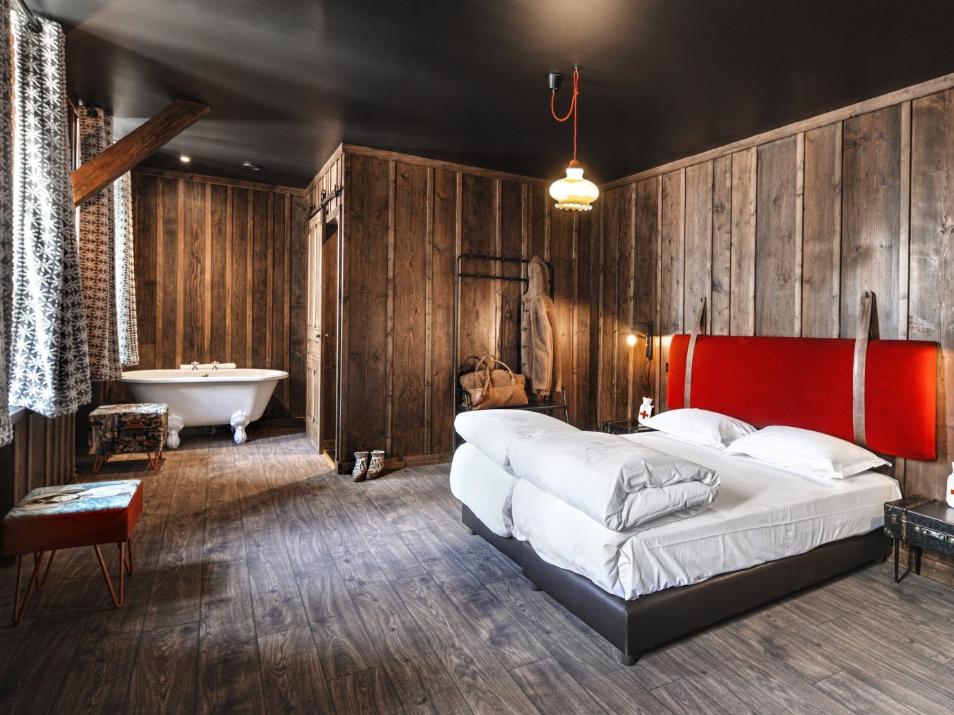 Boutique Hotels Hotels Outdoors + Adventure Winter indoor floor bed room interior design ceiling Architecture wall Suite Bedroom wood bed frame hotel flooring furniture interior designer