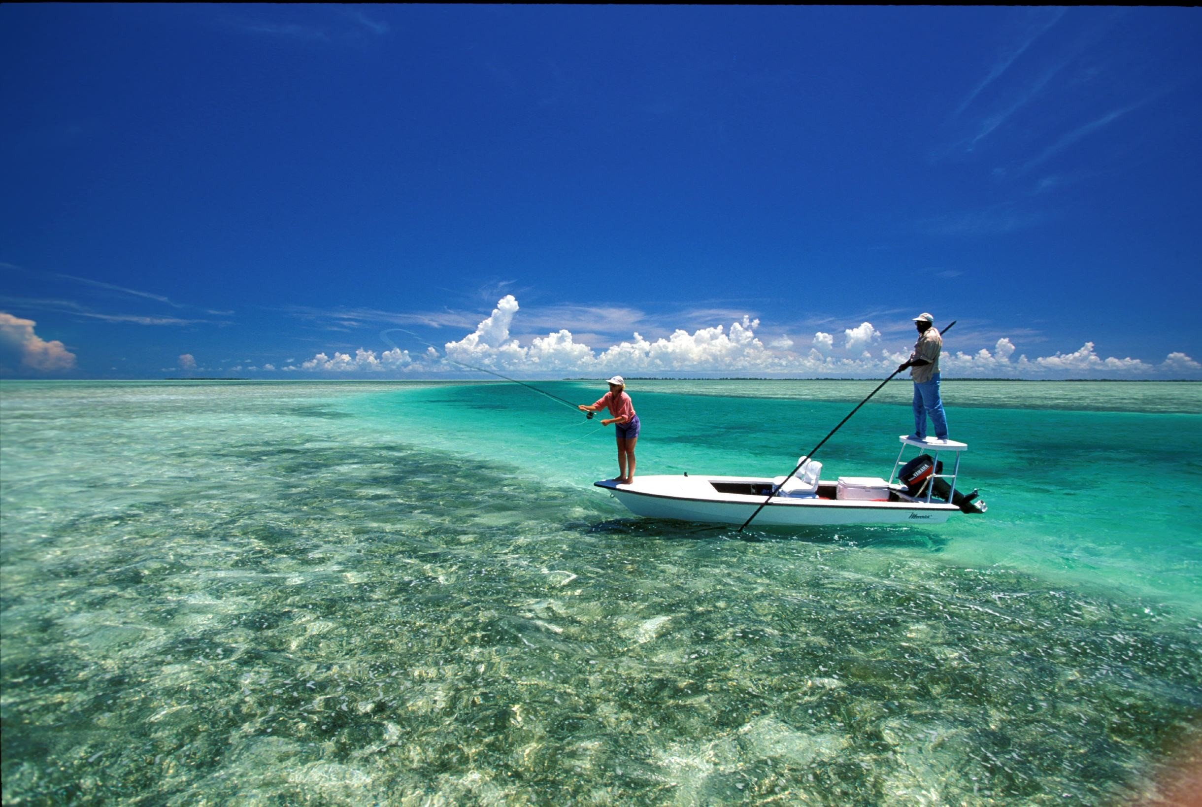 Hotels Islands Luxury Travel Trip Ideas water outdoor sky Boat Sea Ocean windsurfing caribbean vacation wind wave bay vehicle boating sailing Lagoon Coast Beach cape wind Island day