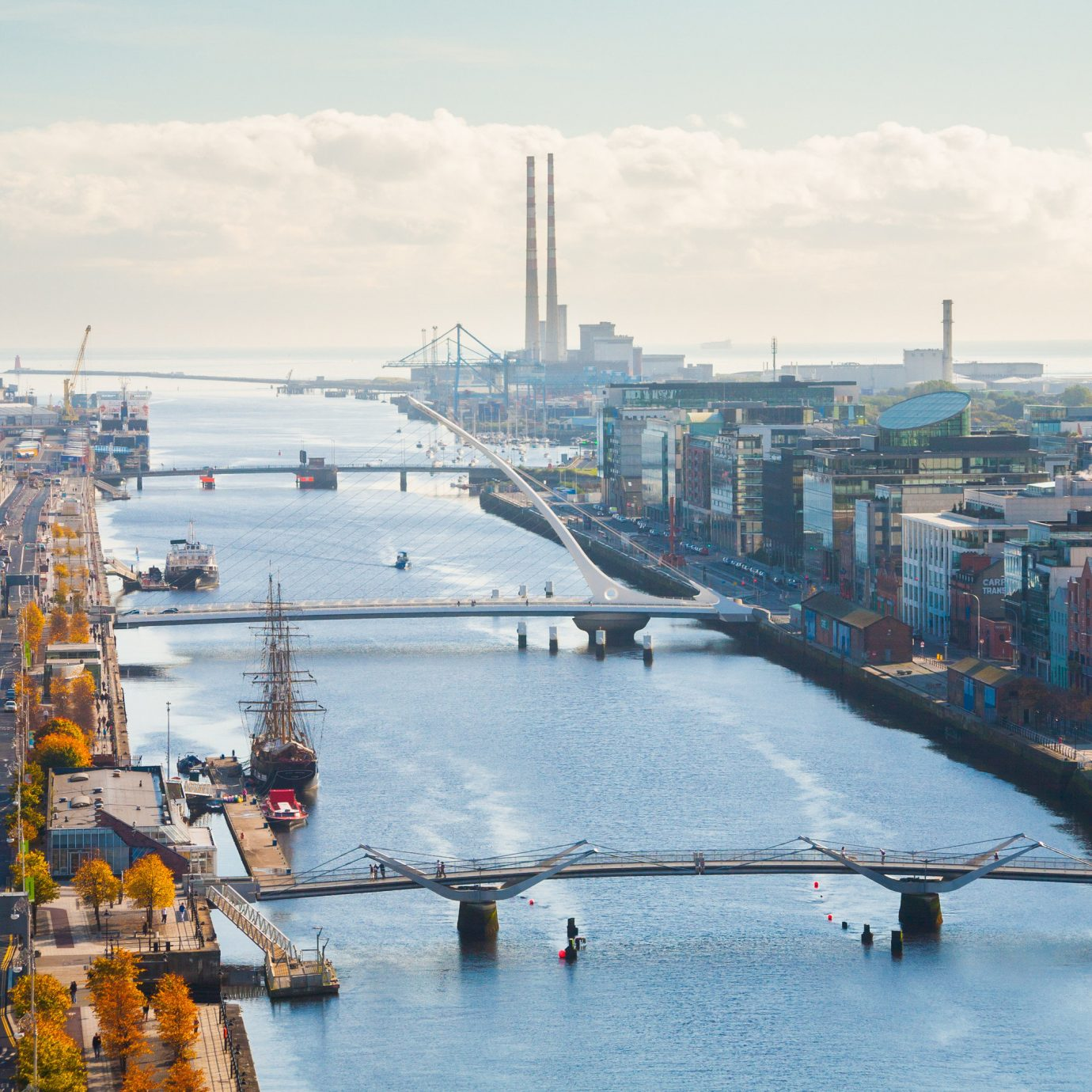 Dublin Hotels Ireland sky outdoor water waterway City urban area metropolitan area Boat cityscape scene skyline port metropolis daytime bird's eye view River channel bridge Harbor Sea horizon fixed link aerial photography Canal day