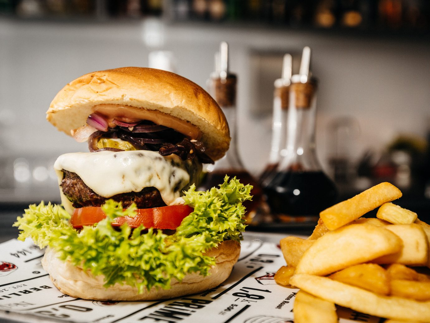 Berlin Boutique Hotels Germany Hotels Luxury Travel food hamburger indoor dish plate fries fast food meal snack food sandwich restaurant sense lunch cheeseburger brunch fast food restaurant tray french fries meat cuisine junk food potato