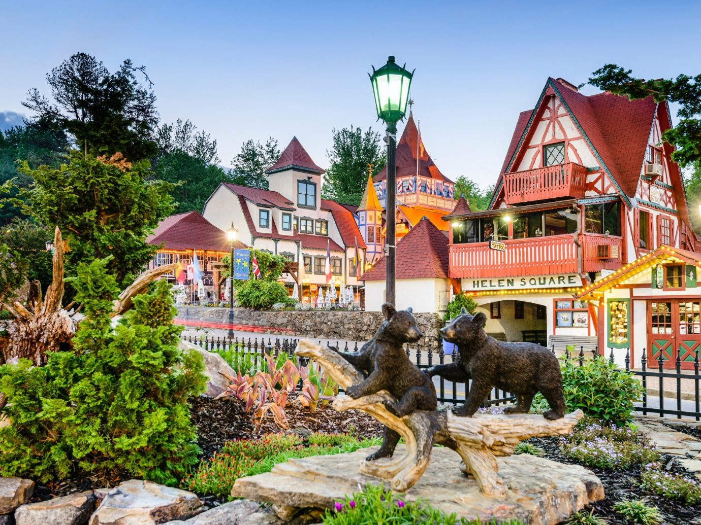 Food + Drink outdoor tree sky house Town vacation tourism Resort home Garden Village amusement park temple stone