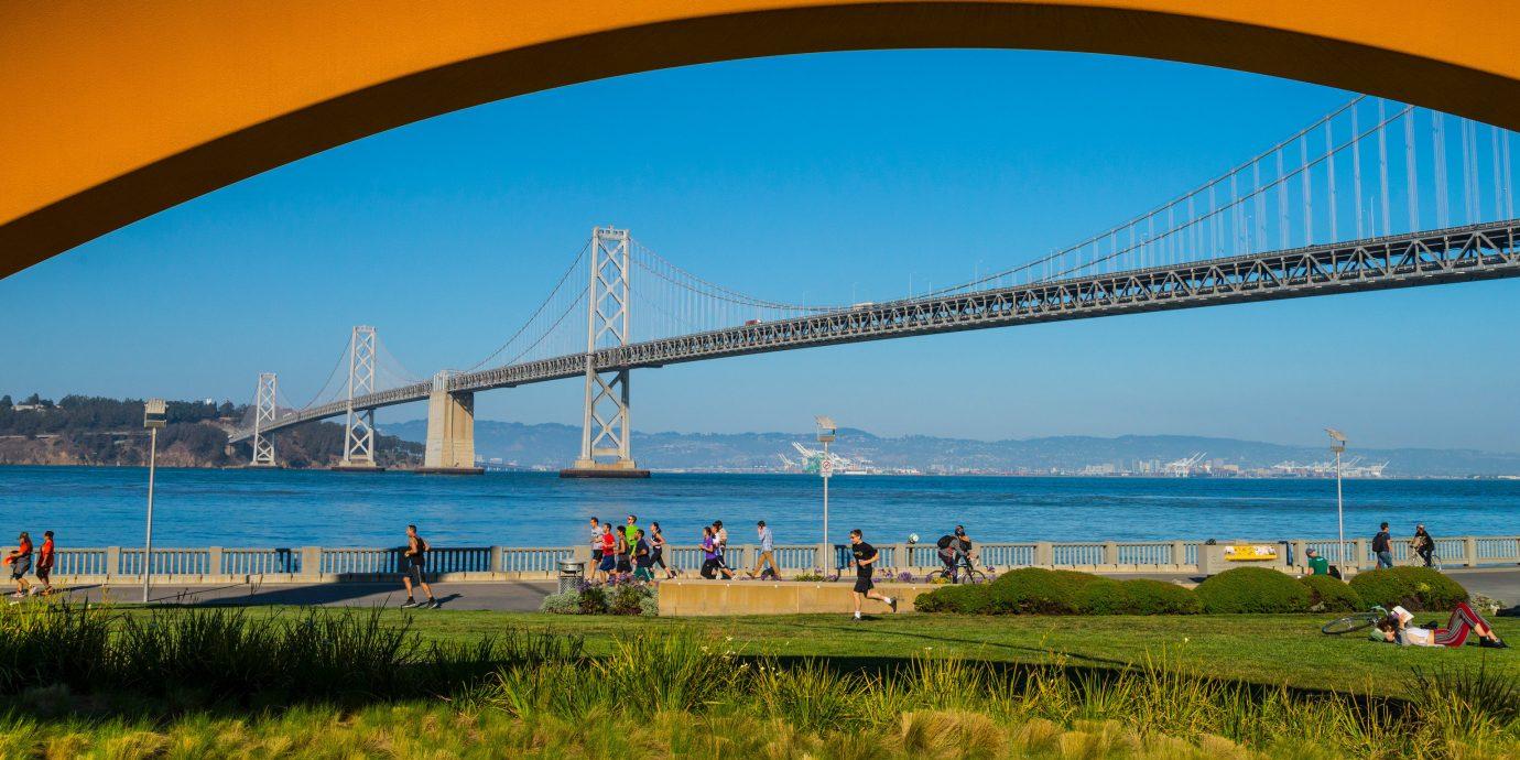 Health + Wellness Trip Ideas grass sky water outdoor building bridge landmark horizon vacation Sea bay Coast nonbuilding structure cable stayed bridge