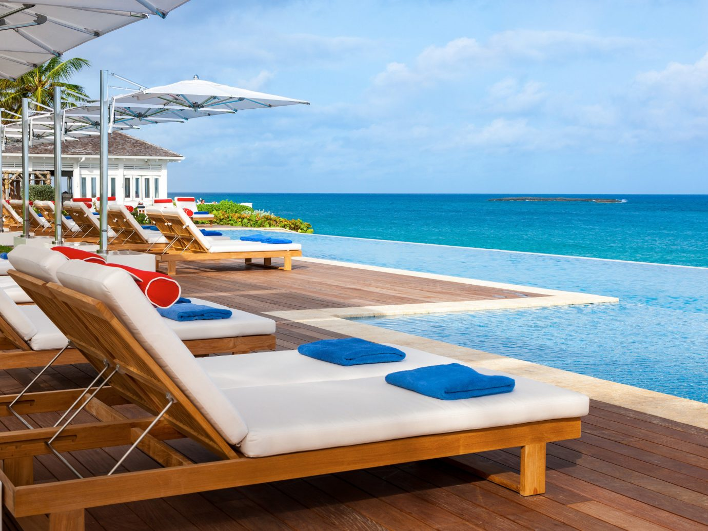Hotels Romance Trip Ideas sky water chair outdoor leisure Beach property swimming pool vacation caribbean Resort Ocean Sea furniture estate Villa Deck