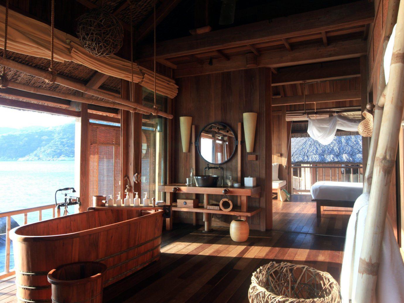 Travel Tips indoor window property room estate house ceiling home cottage interior design Resort log cabin Villa real estate farmhouse mansion wood furniture