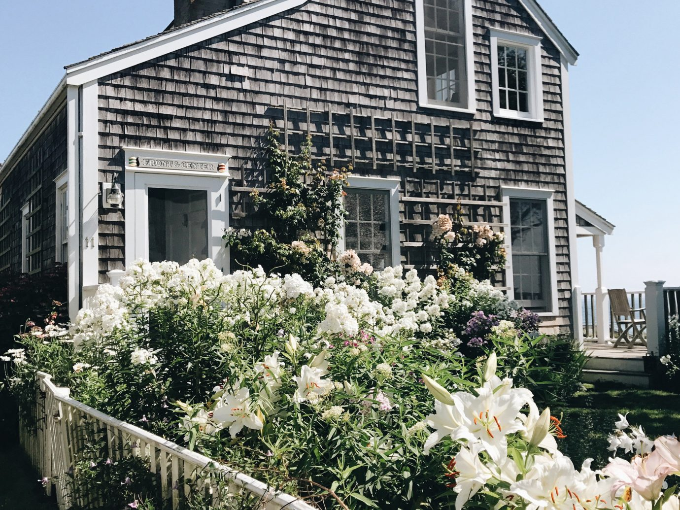 Boutique Hotels Health + Wellness Hotels Trip Ideas tree building outdoor house home cottage property residential area flower real estate farmhouse window estate siding suburb facade Garden historic house outdoor structure plant mansion roof landscaping stone