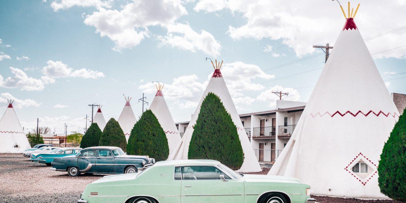 Offbeat tepee sky building car outdoor vehicle wheel automobile make green