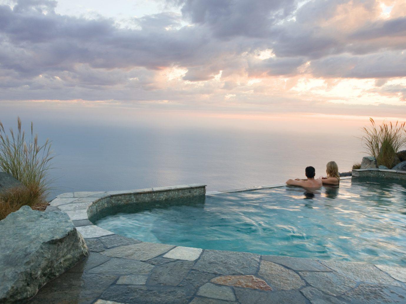 Hotels Romance sky water outdoor Sea shore swimming pool vacation Ocean horizon Nature Coast Beach bay Lagoon Lake swimming