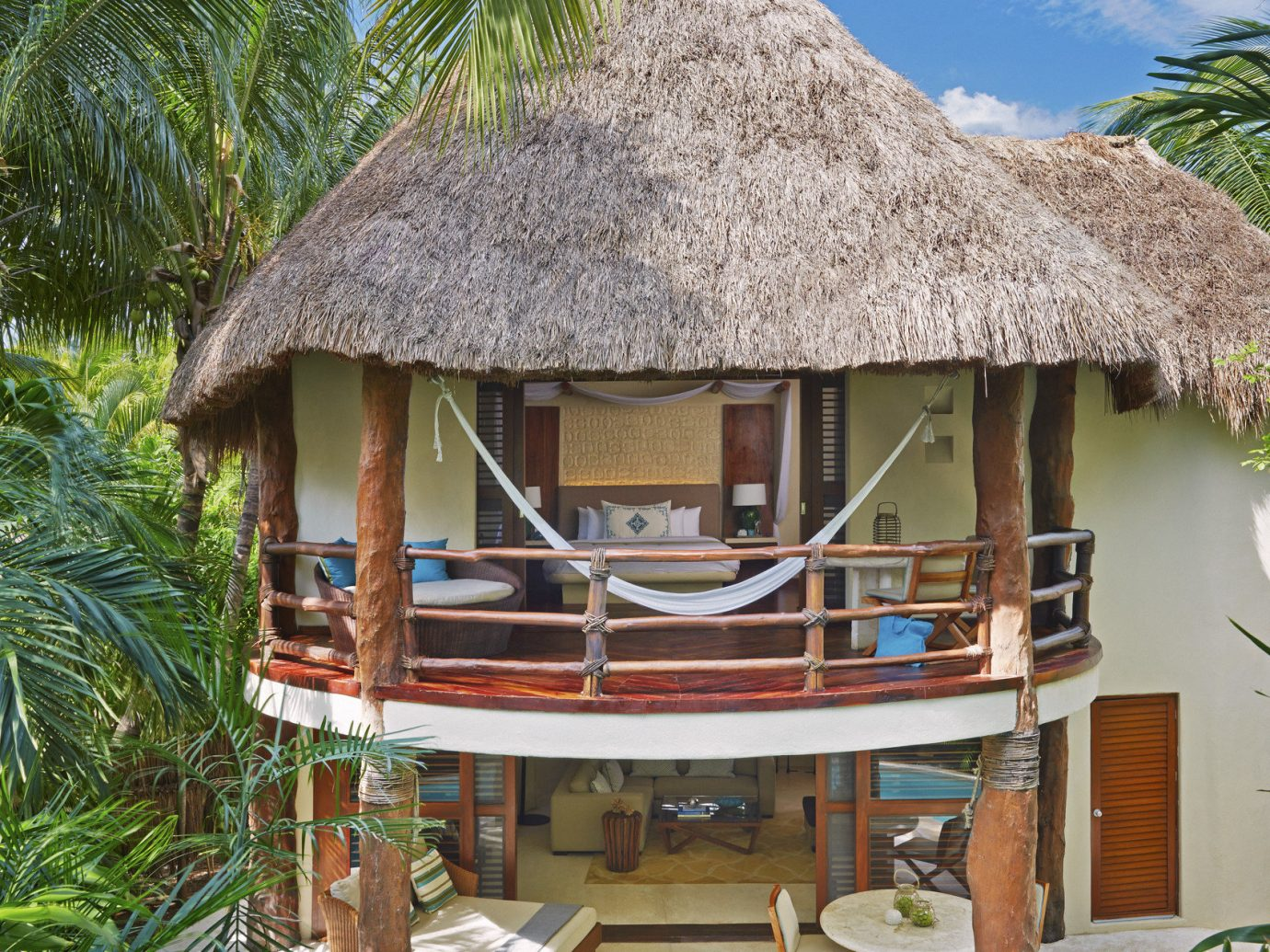 Beach Honeymoon Hotels Mexico Romance Tulum tree outdoor chair property Resort hut thatching cottage roof Jungle area furniture surrounded