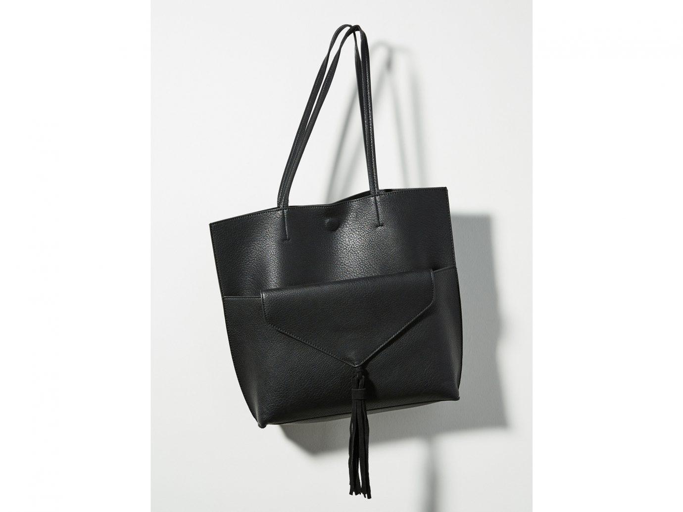 Packing Tips Style + Design Travel Shop Weekend Getaways bag handbag black shoulder bag fashion accessory product leather tote bag product design brand luggage & bags