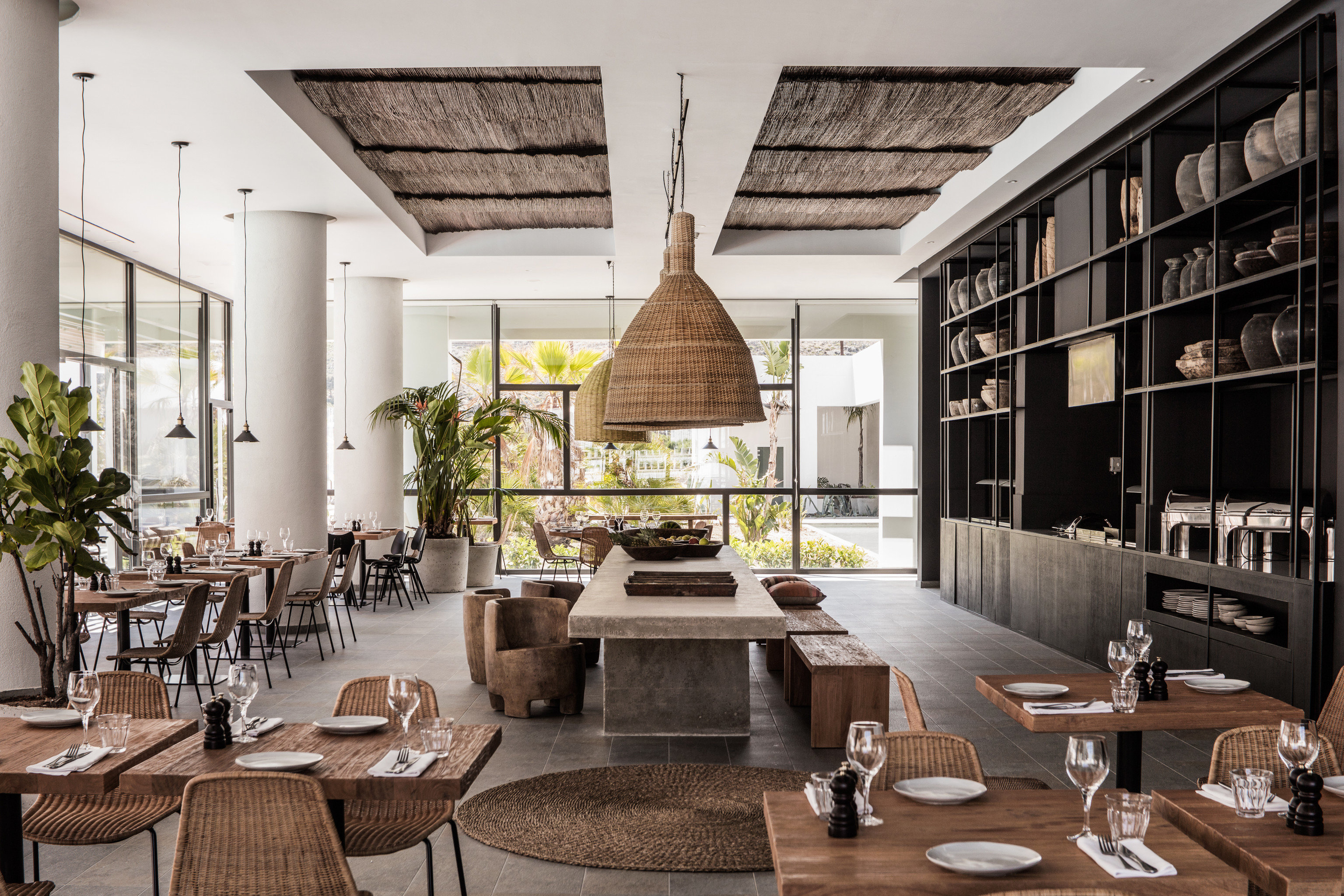 Boutique Hotels Hotels indoor table room Living living room dining room property home estate condominium interior design real estate wood Dining Design loft farmhouse window covering furniture area