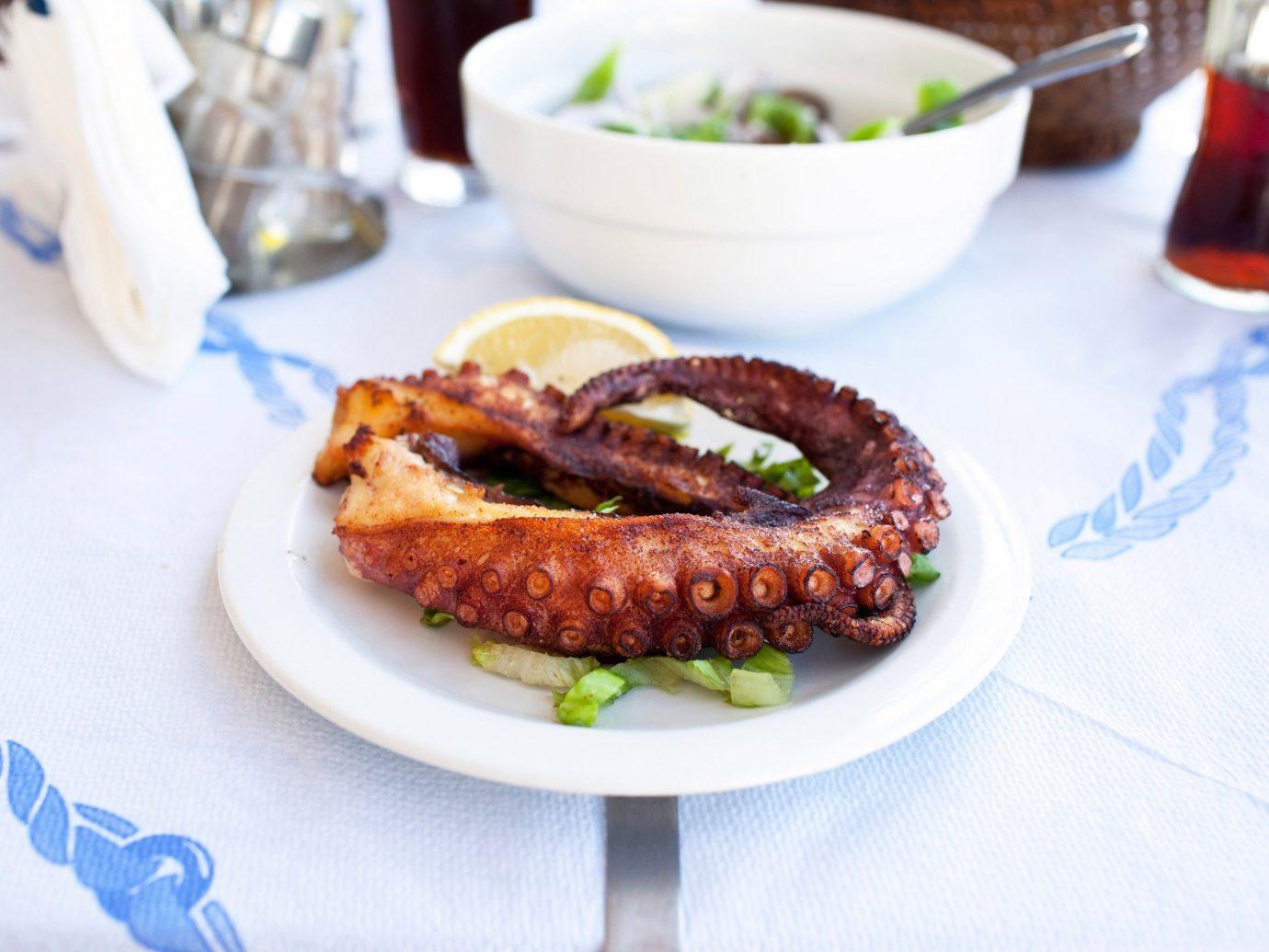 Trip Ideas plate table food dish meat fried food meal breakfast produce cuisine vegetable bratwurst sausage