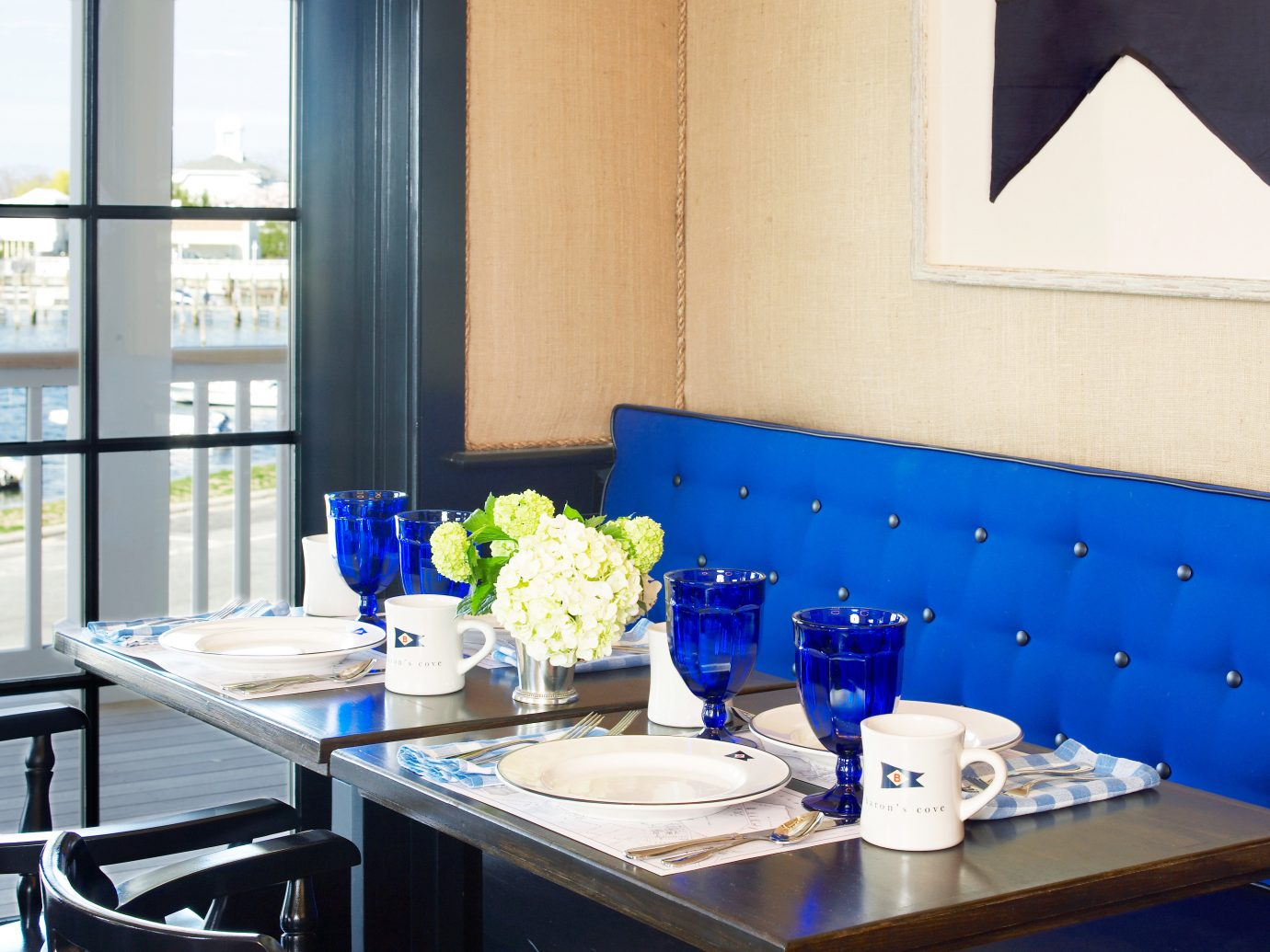 Boutique Dining Eat Modern Secret Getaways Trip Ideas table indoor blue room window dining room interior design restaurant home Design window covering living room apartment Kitchen dining table