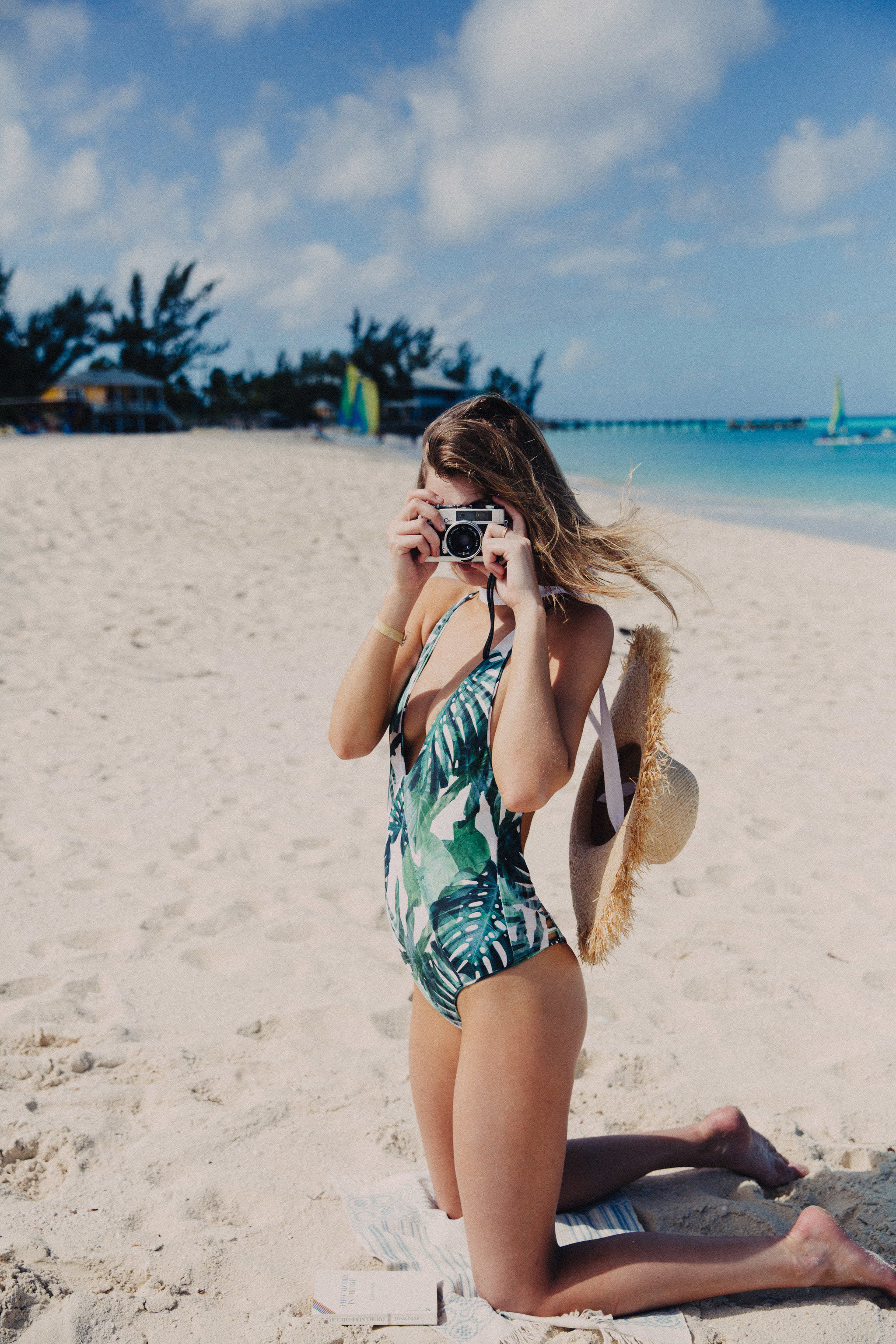 Hotels Style + Design Travel Shop Trip Ideas outdoor Beach sky person swimwear woman ground clothing vacation Sea summer girl fun sun tanning model shorts sand swimsuit Ocean long hair photo shoot shore sandy