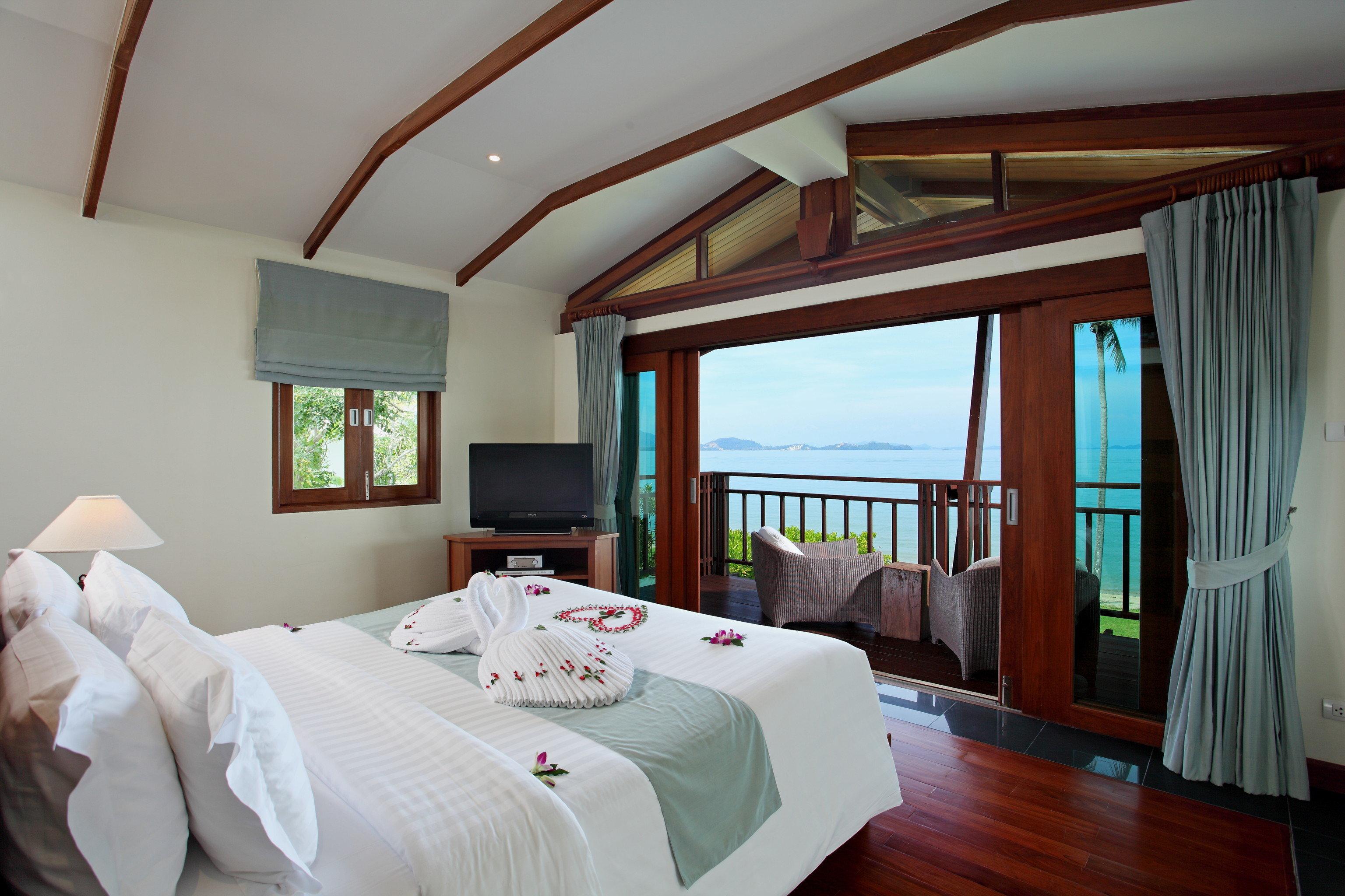 Beach Hotels Phuket Thailand indoor bed wall room floor Bedroom hotel ceiling Suite interior design pillow real estate estate window boarding house Resort wood furniture
