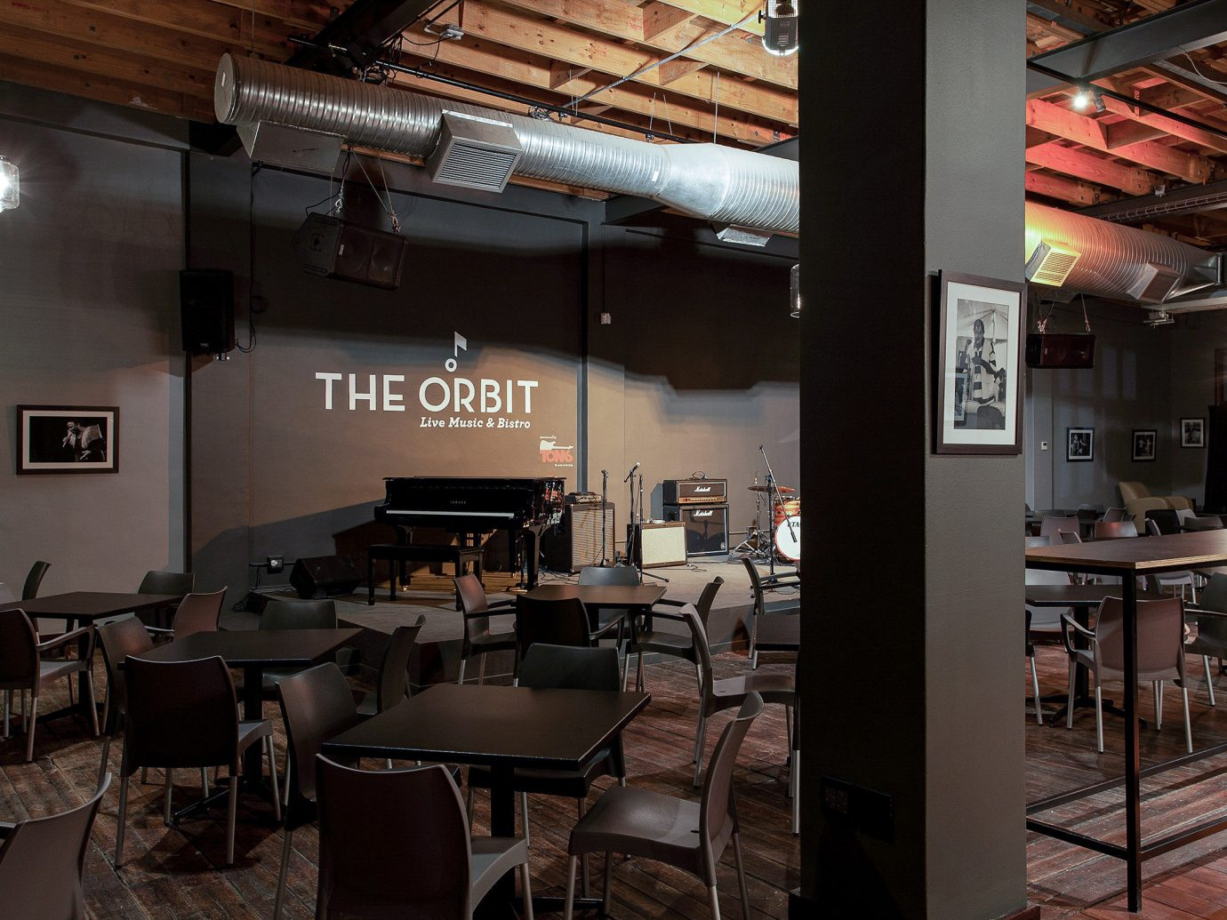Arts + Culture Trip Ideas indoor chair floor room restaurant interior design ceiling café coffeehouse table area furniture several