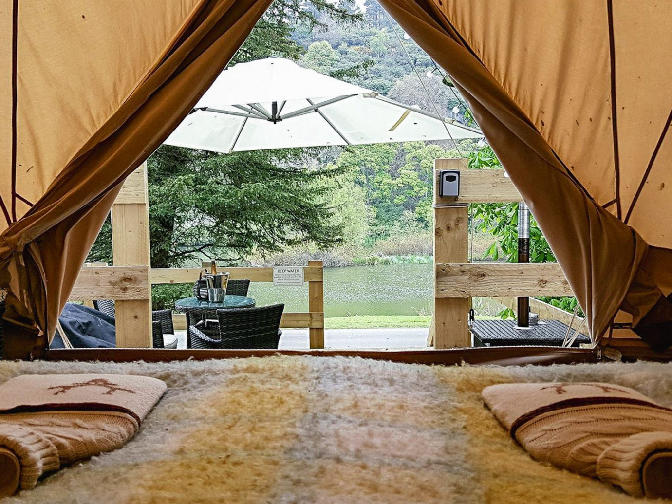 Glamping Outdoors + Adventure Trip Ideas property tent room wood home interior design window estate real estate house daylighting