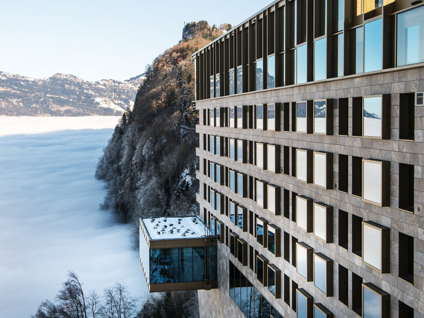 Boutique Hotels Hotels Luxury Travel outdoor sky tree Winter snow building reflection condominium Architecture water urban area residential area City apartment house real estate freezing facade home window mountain mountain range ice glacial landform