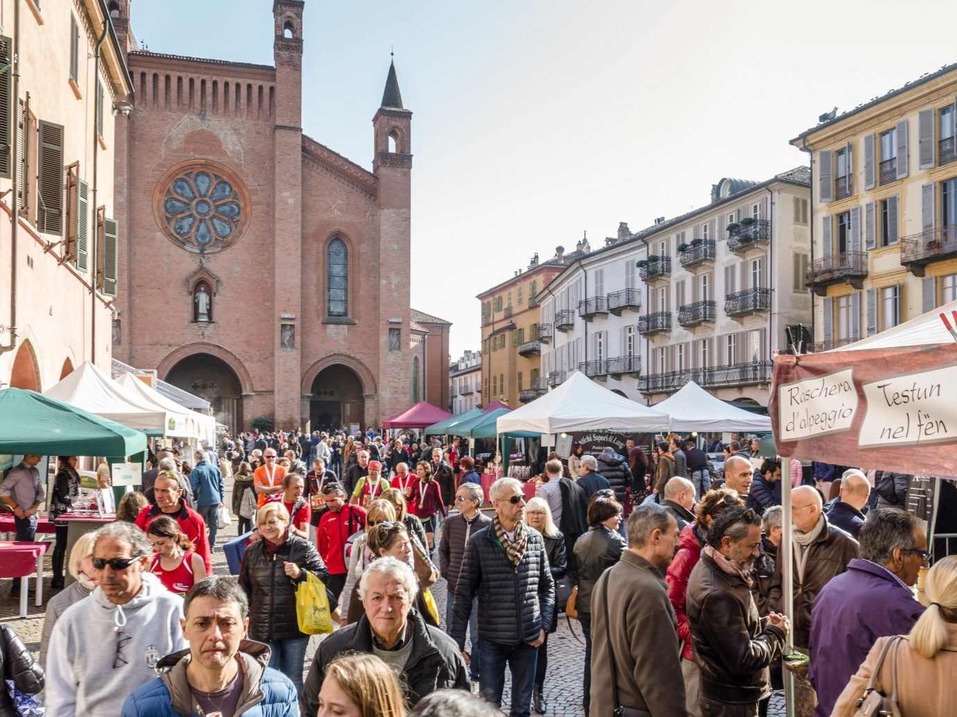 Food + Drink Hotels Italy Luxury Travel Trip Ideas building person outdoor people marketplace market City public space street Town crowd bazaar stall tourism group flea market fair fête town square Downtown pedestrian