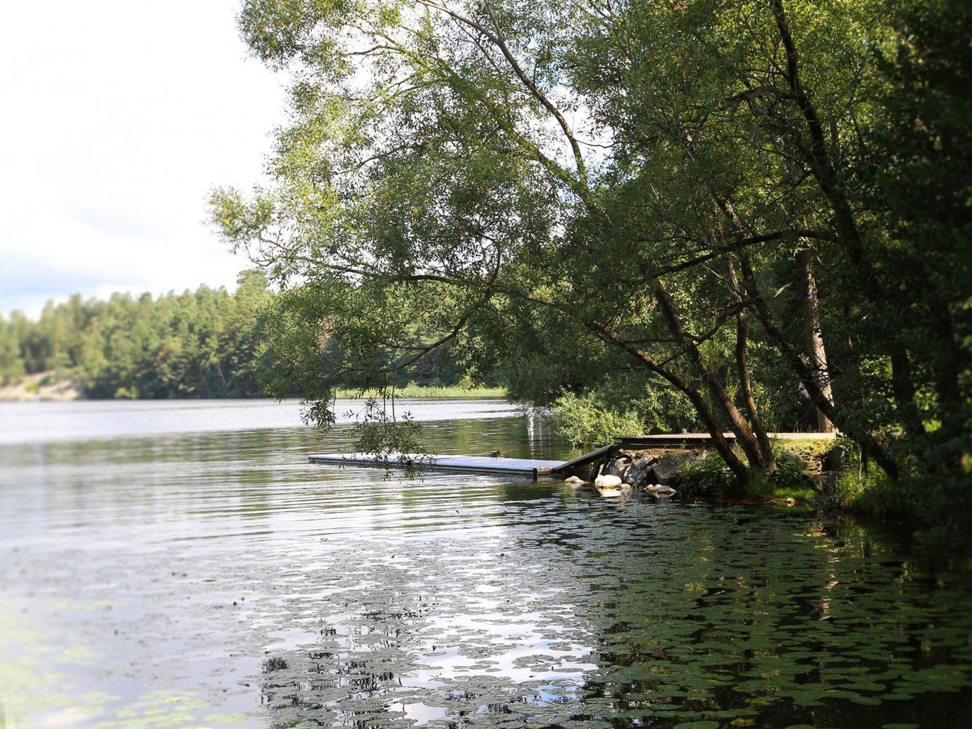 Denmark Finland Hotels Landmarks Luxury Travel Sweden tree outdoor water bayou Nature body of water River Lake pond waterway wetland reservoir day