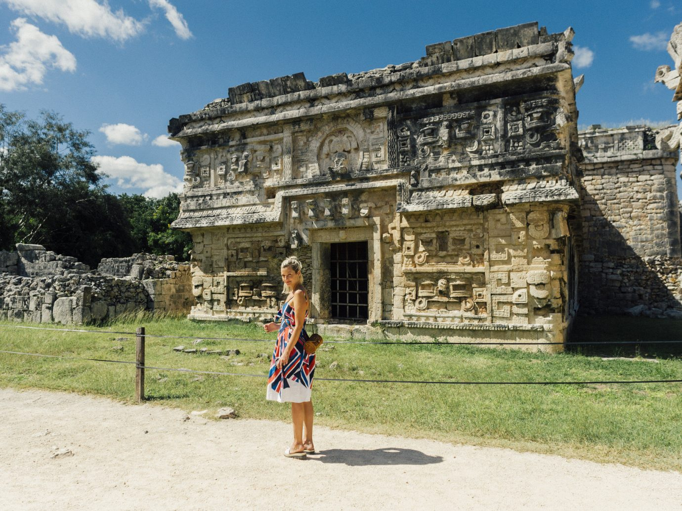 Influencers + Tastemakers Travel Lifestyle Ruins historic site archaeological site ancient history maya civilization sky tourism wall history temple building grass travel maya city vacation monument tree facade