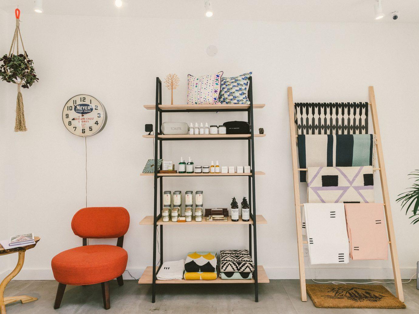 City Trip Ideas Weekend Getaways wall indoor floor room furniture shelving shelf Living interior design product design product table area