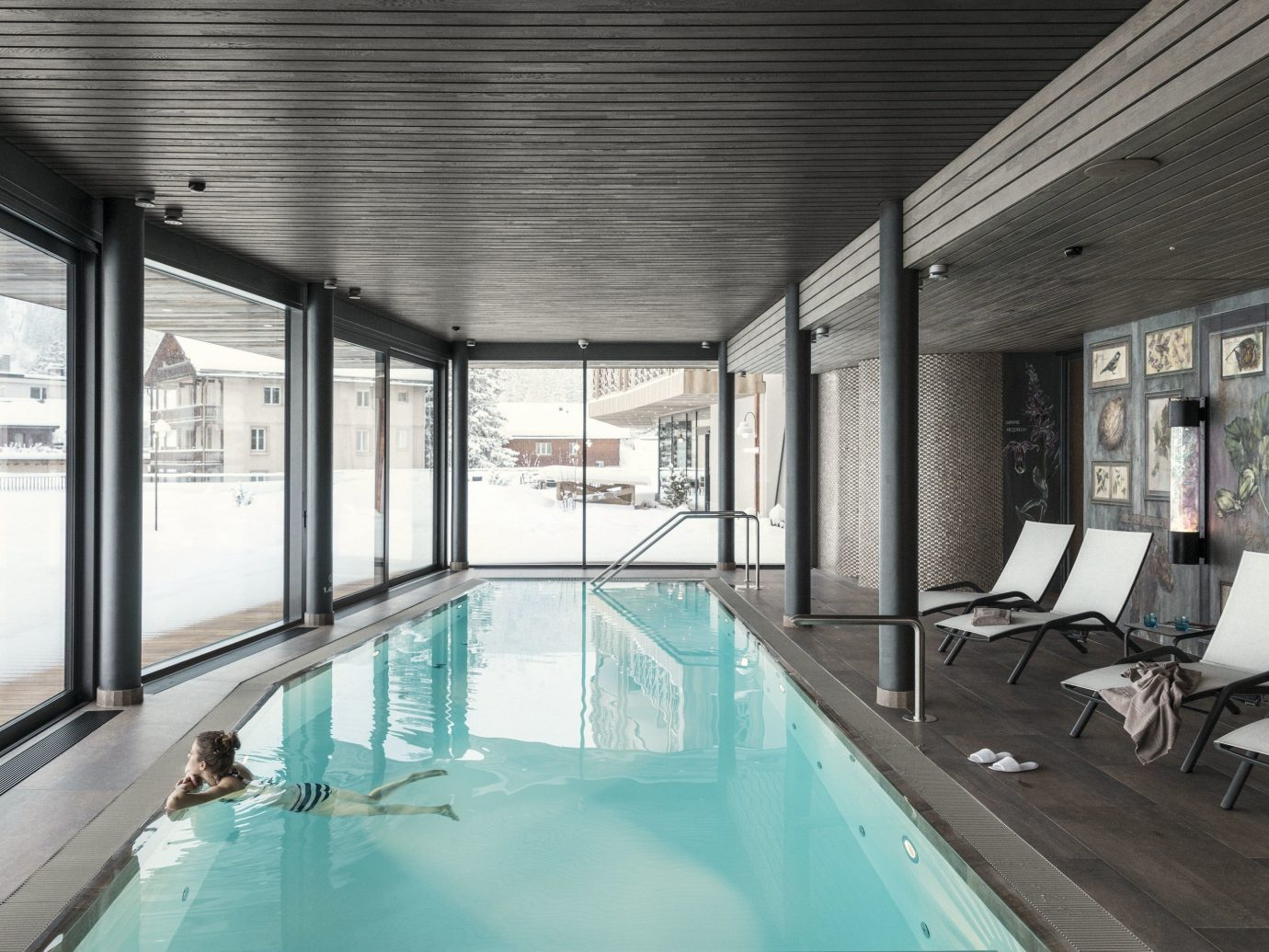Boutique Hotels Hotels Outdoors + Adventure Winter indoor window ceiling property room swimming pool real estate interior design estate daylighting apartment amenity furniture