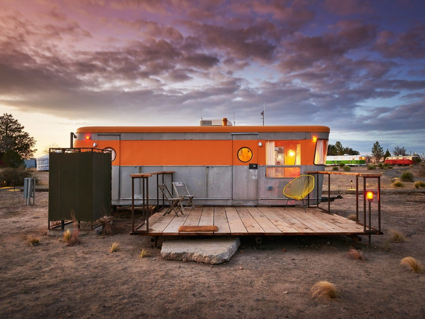 airstream ambient lighting artistic artsy calm dawn dusk Exterior Hip Hotels isolation Patio porch quirky remote serene Solo Travel Terrace trendy Trip Ideas sky ground outdoor transport orange shack cloudy