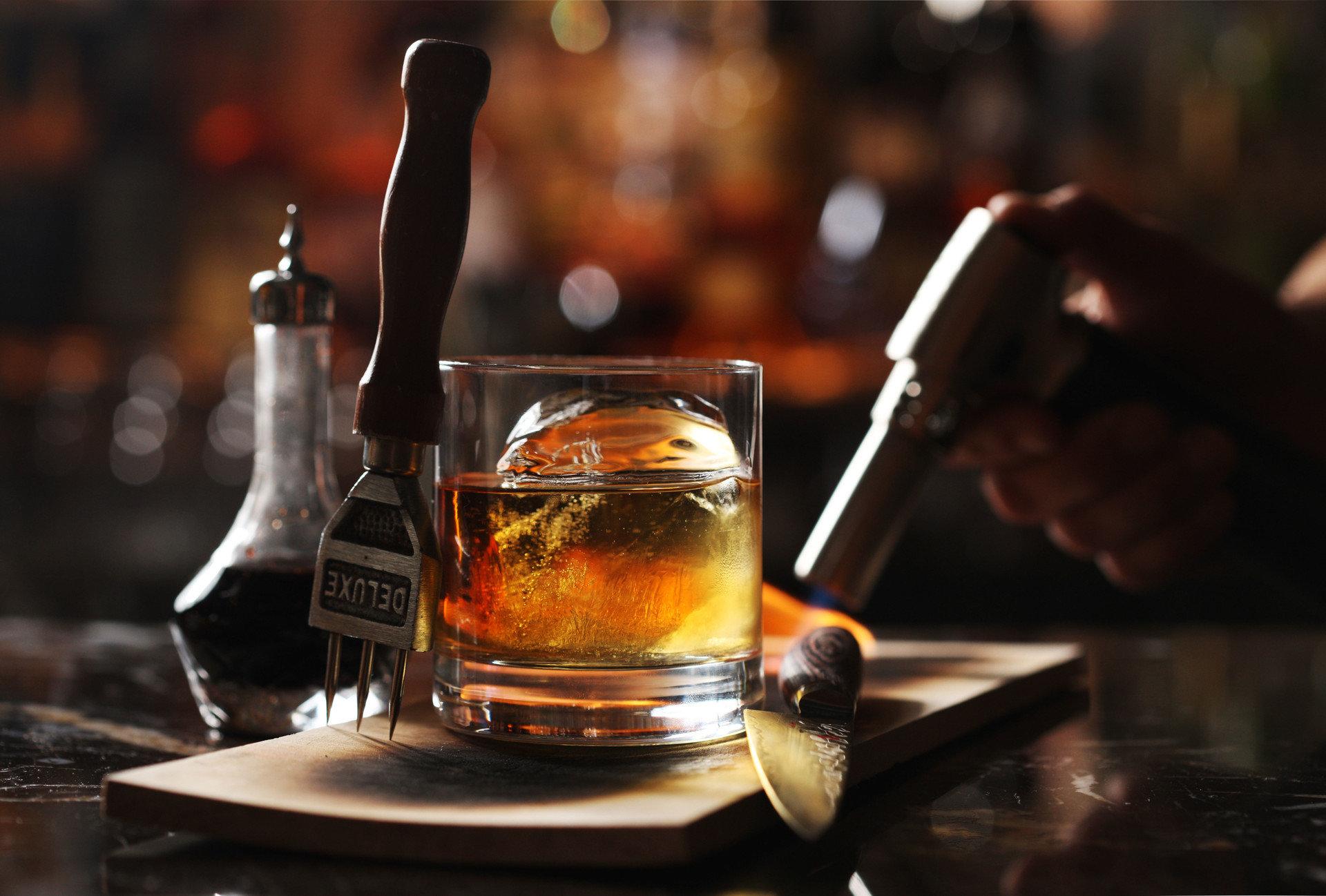 bourbon cocktails craft cocktail Drink drinks Food + Drink gourmet Offbeat scotch whiskey table indoor alcoholic beverage distilled beverage alcohol whisky cocktail liqueur Bar glass