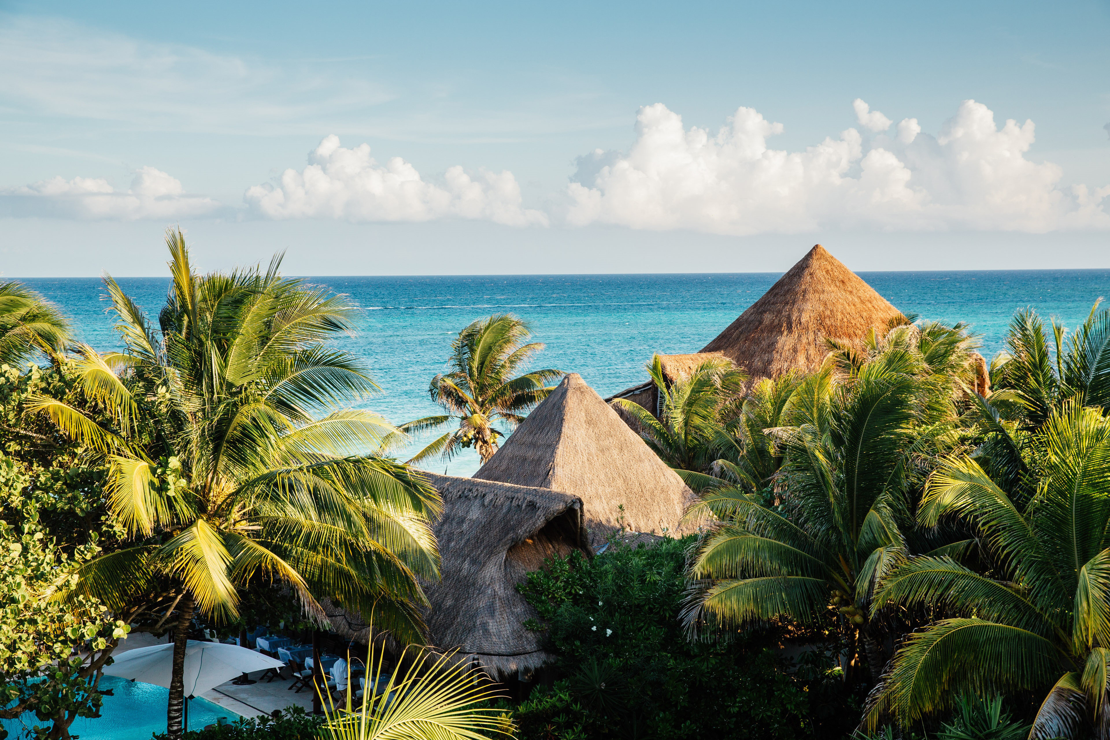 Beach Exterior Hotels Luxury News Ocean Rustic Scenic views Tropical sky outdoor water tree plant Sea geographical feature vacation caribbean body of water Coast shore tropics Nature arecales tourism bay cape Island Resort palm family Lagoon beautiful palm overlooking shade