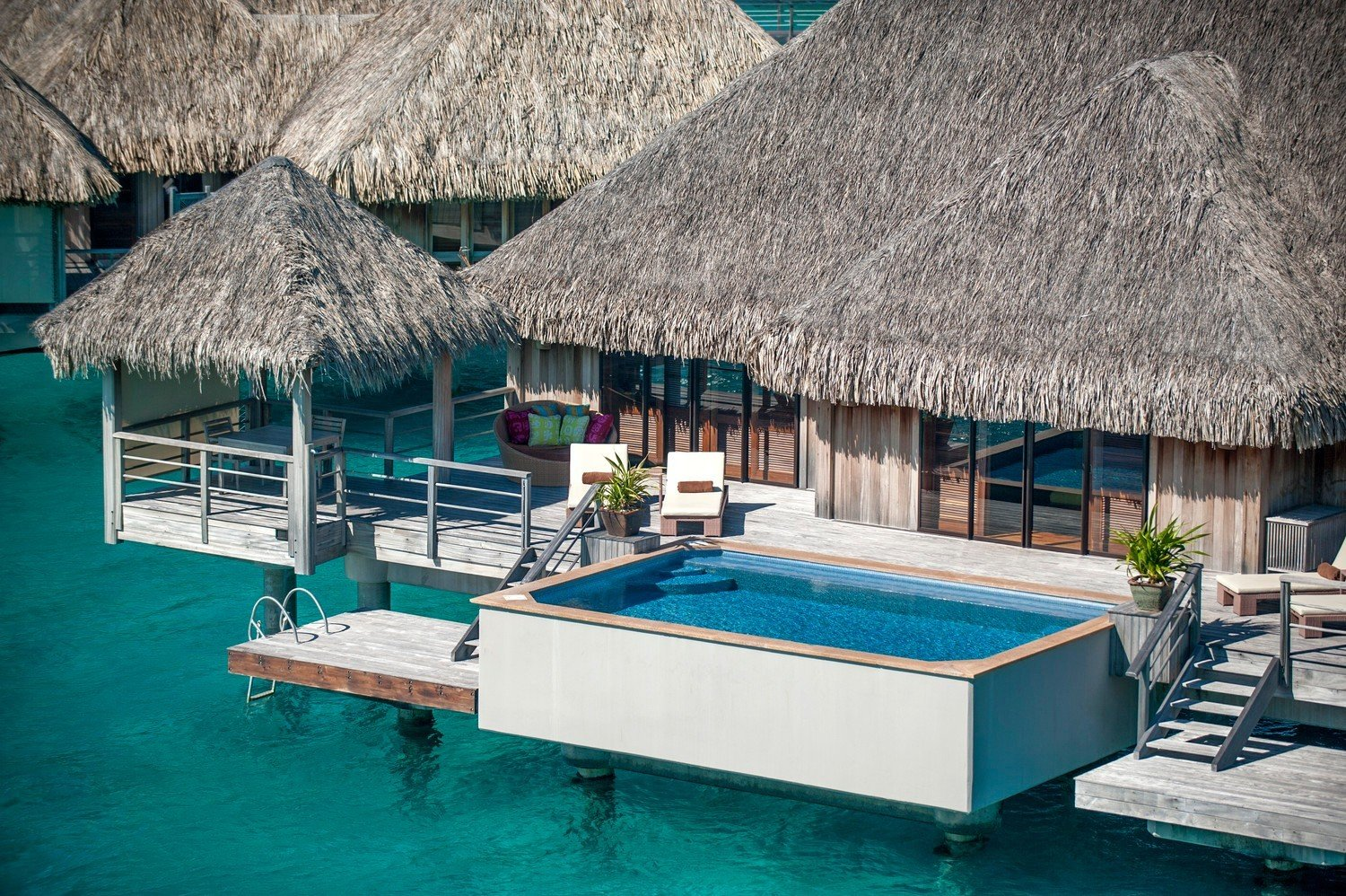 All-Inclusive Resorts Boutique Hotels Hotels Romance roof umbrella chair building leisure Pool blue swimming pool Resort hut lawn furniture swimming several