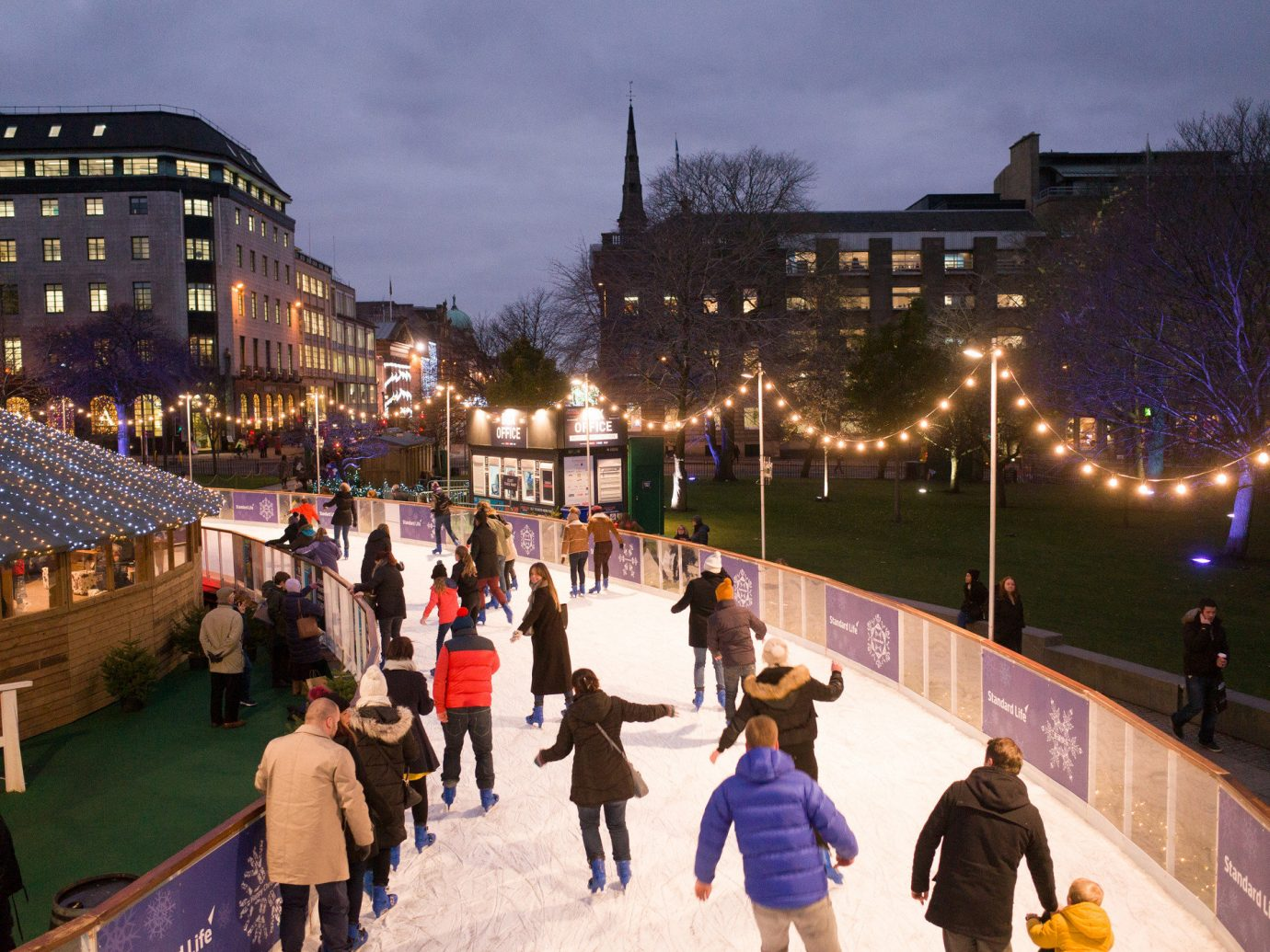 Trip Ideas outdoor person crowd City night rink ice rink town square evening tourism plaza cityscape line