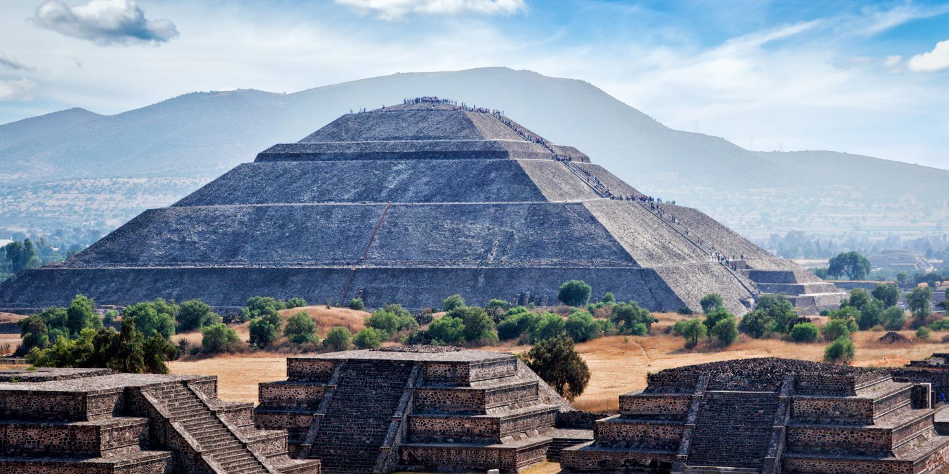 Arts + Culture Mexico City Travel Tips Trip Ideas historic site landmark maya civilization sky pyramid archaeological site ancient history monument tourist attraction cloud Ruins unesco world heritage site wonders of the world tourism mountain badlands roof maya city