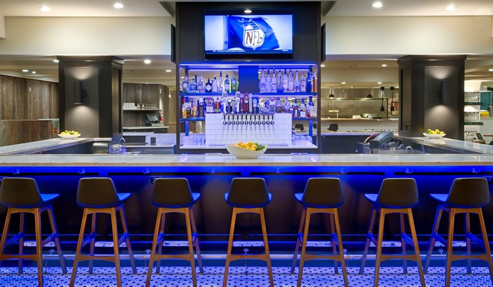 Bar at Hilton Portland Downtown with blue lighting under the bar