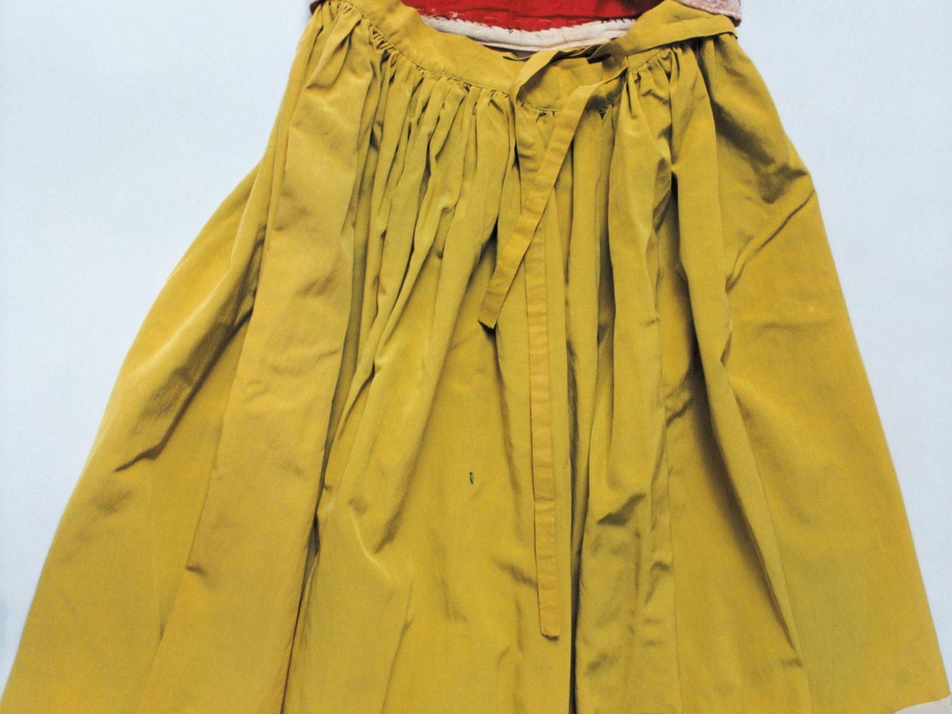 Arts + Culture clothing yellow skirt dress abdomen Design pattern jacket trunk