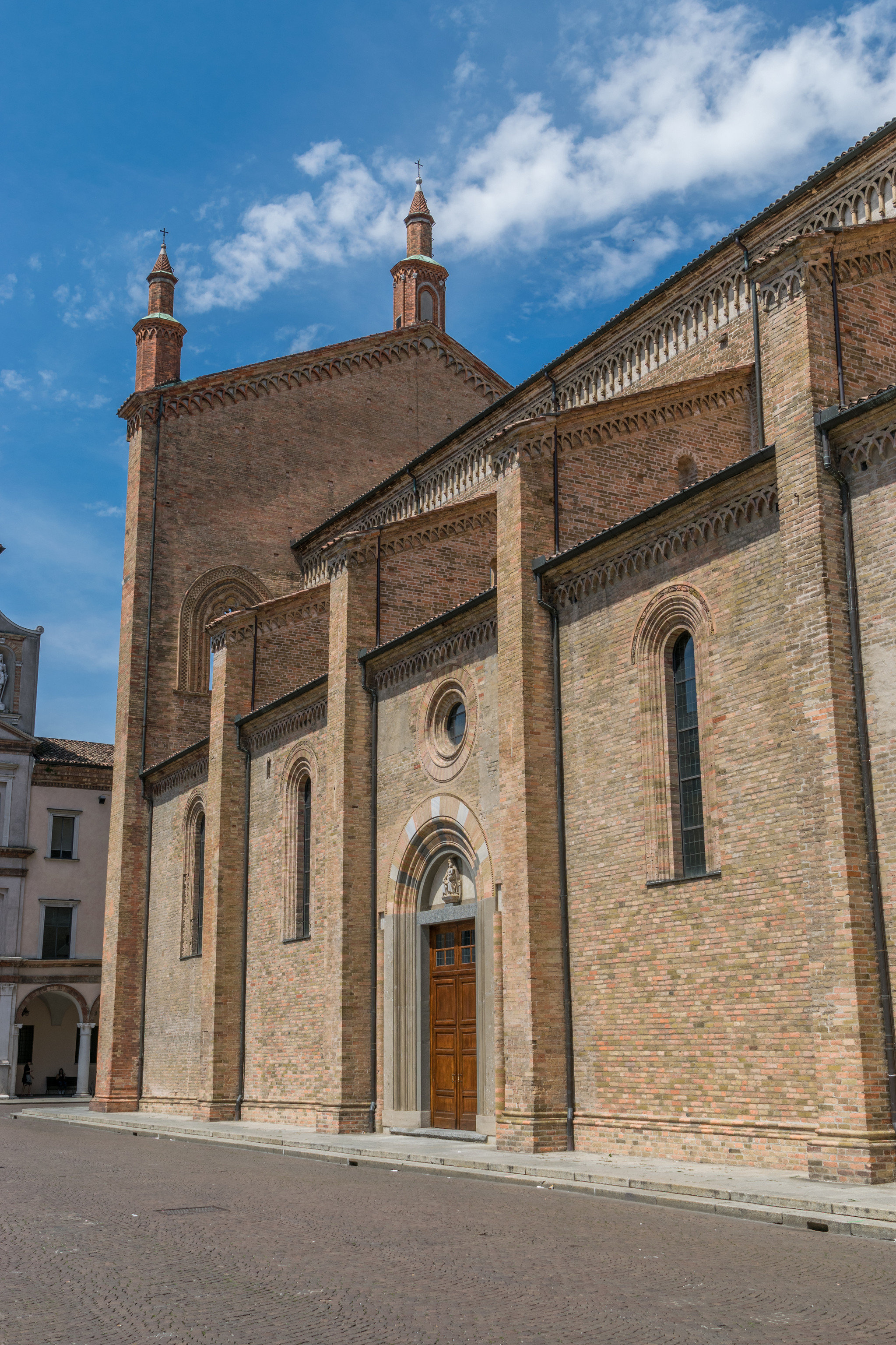 Arts + Culture Italy Milan Trip Ideas building sky outdoor brick historic site medieval architecture wall Church place of worship history basilica facade window arch stone old bell tower almshouse column chapel cathedral parish tall roof
