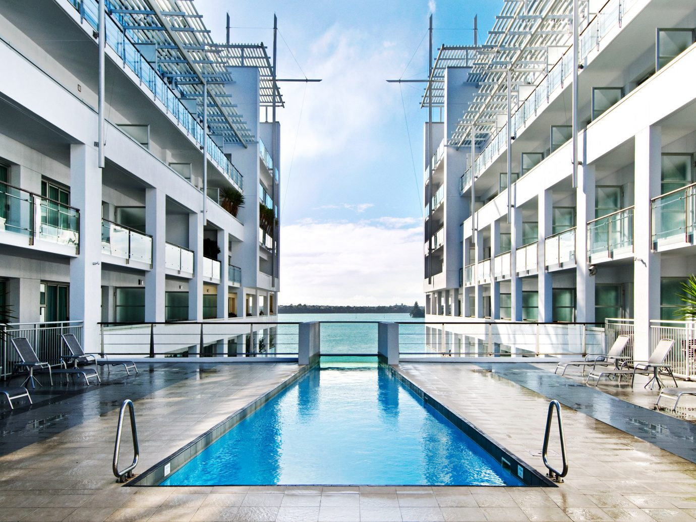 Architecture Boutique Hotels Festivals + Events Hotels Play Pool Resort Trip Ideas Waterfront water ground outdoor leisure swimming pool condominium building plaza headquarters estate facade blue swimming