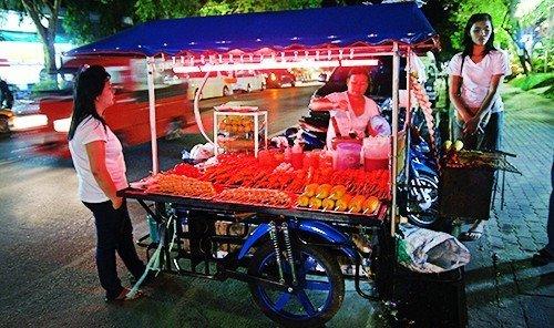 Food + Drink outdoor vendor vehicle cart marketplace food street food stall pulling