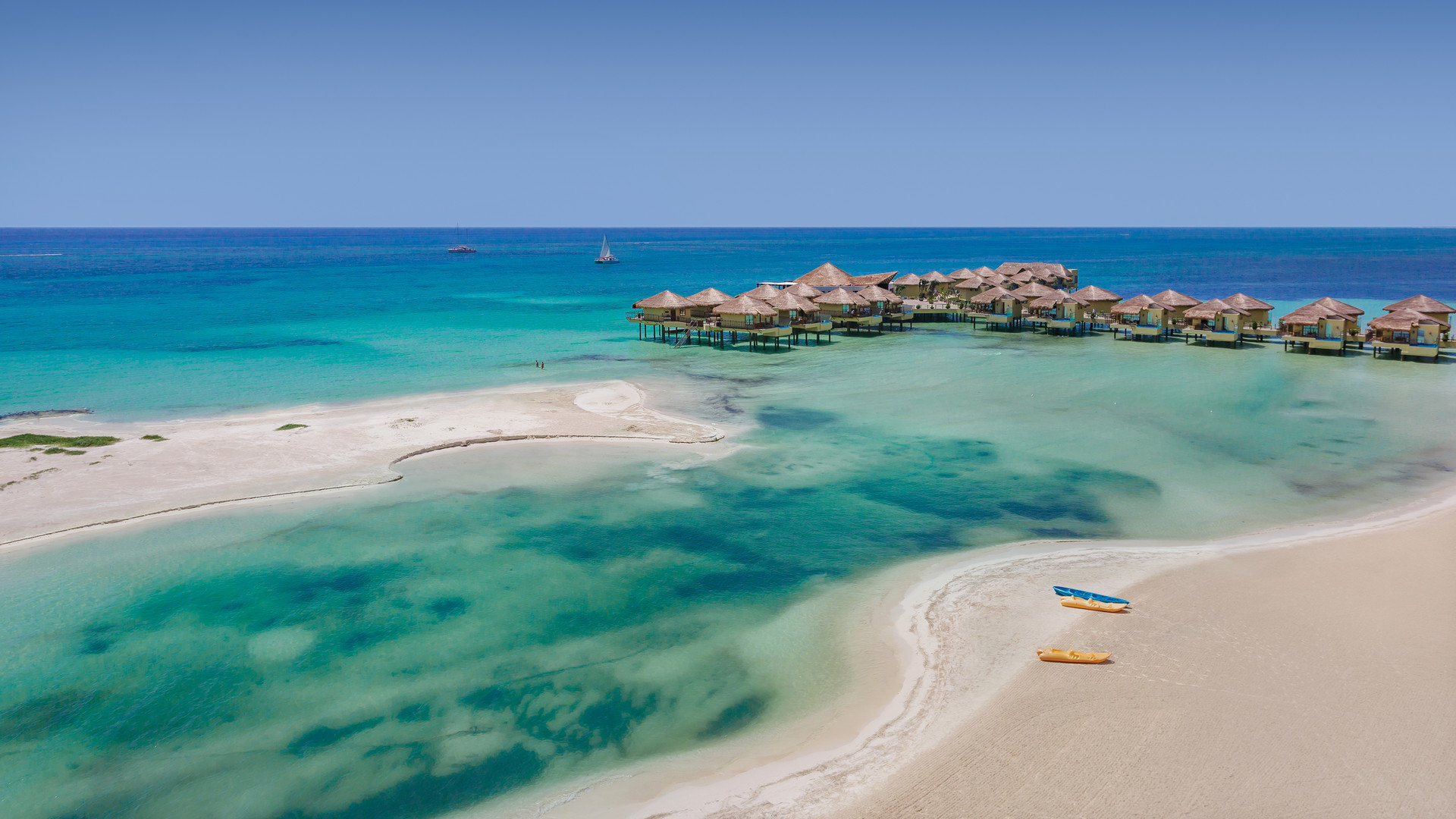 Hotels sky water outdoor Nature Beach landform geographical feature shore body of water Coast Sea Ocean caribbean vacation bay cape Lagoon sand islet wind wave Island