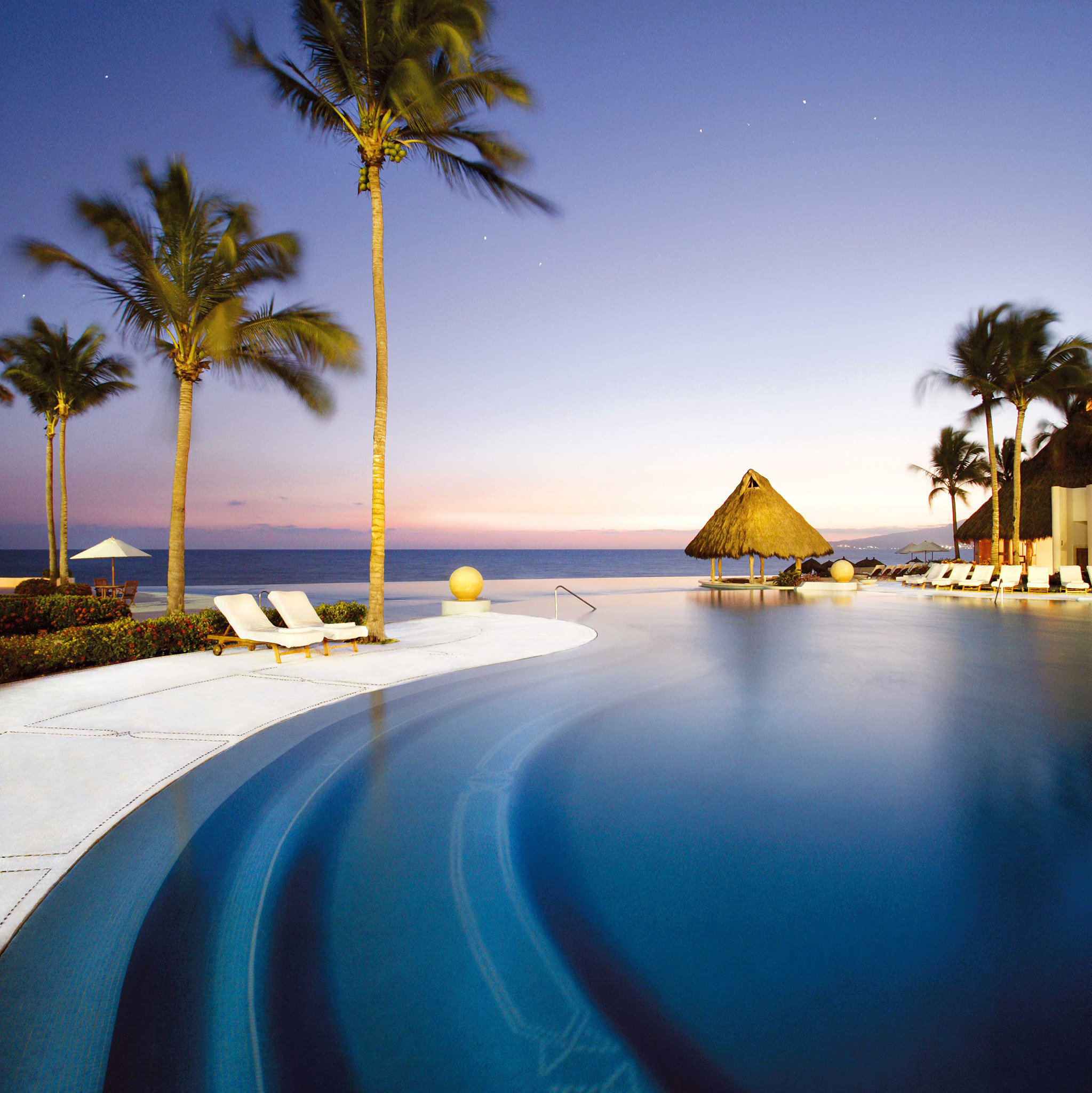 All-Inclusive Resorts Beach Beachfront Hotels Patio Pool Resort Romance Romantic Sunset Tropical sky tree outdoor palm Sea Ocean vacation swimming pool reflection arecales morning caribbean sunlight evening dusk bay tropics palm family shore