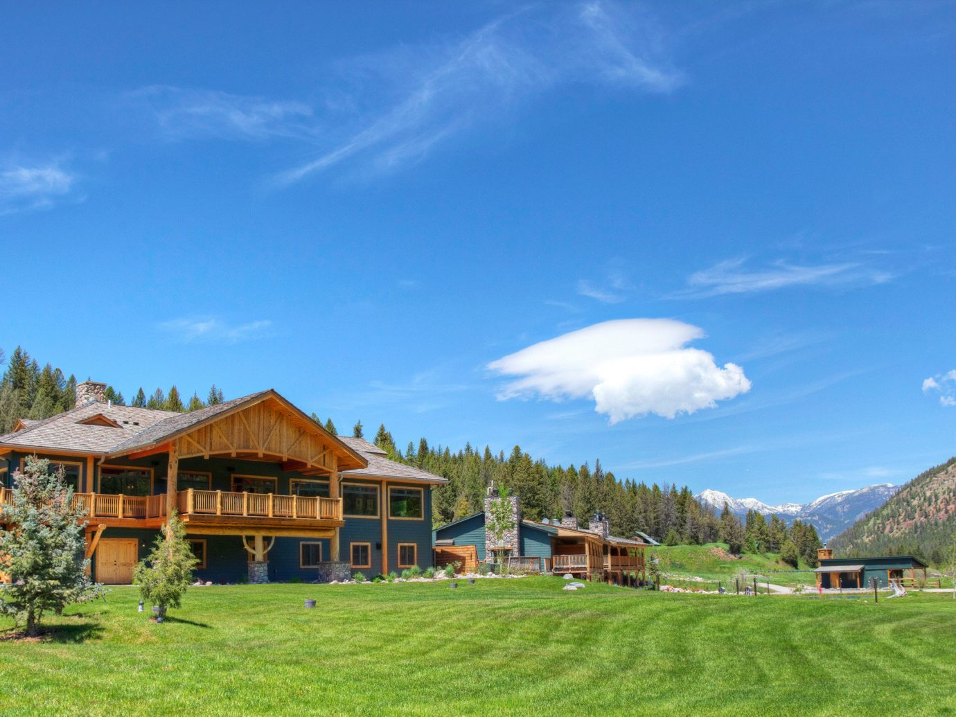 Country Exterior Glamping Grounds Hotels Lodge Montana Nature Outdoors Outdoors + Adventure Ranch Rustic Trip Ideas grass sky outdoor mountainous landforms house field mountain range mountain green estate rural area old landscape Resort valley meadow Village Farm plateau grassy lush hillside