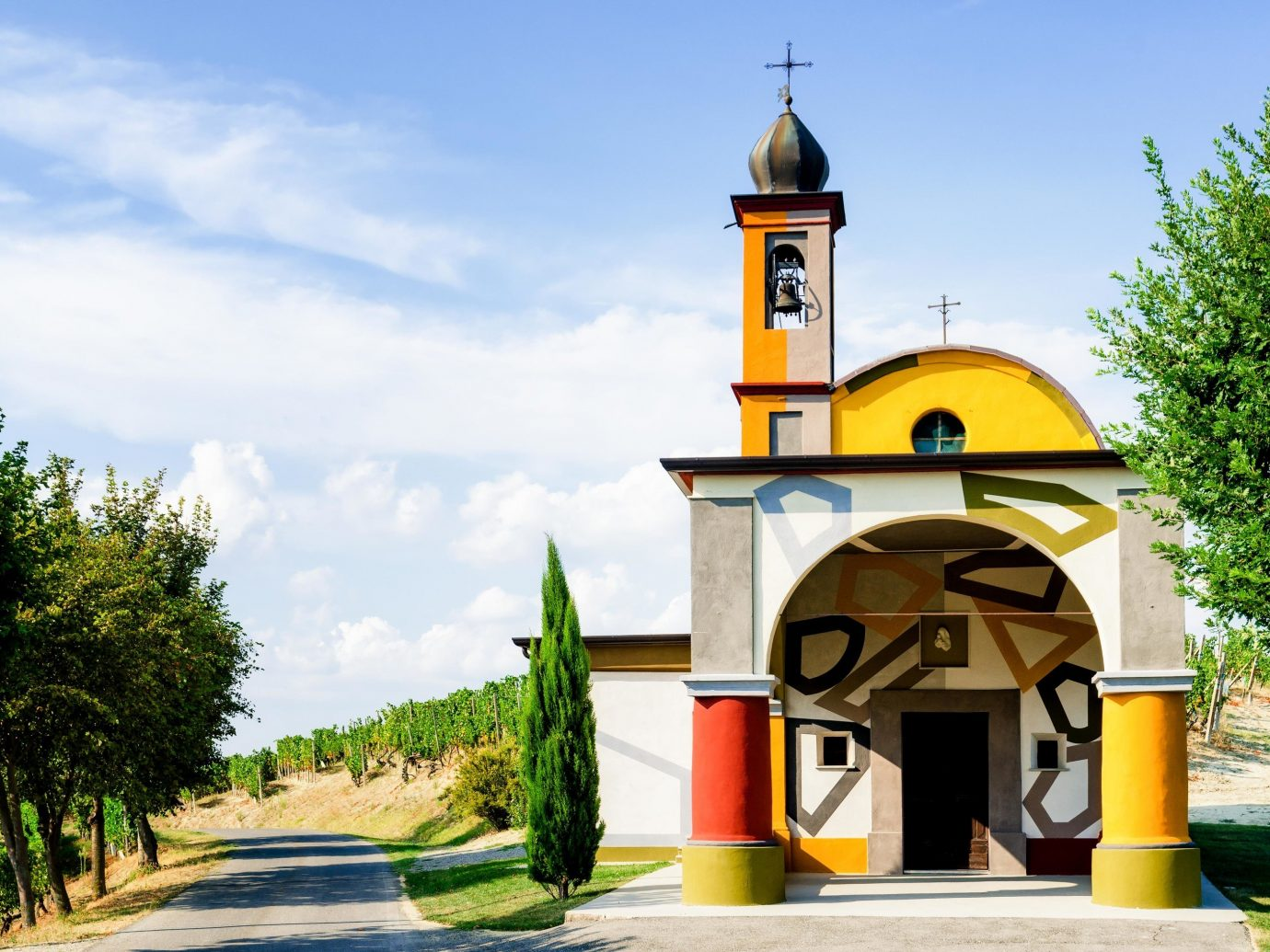 Food + Drink Hotels Italy Luxury Travel Trip Ideas sky outdoor tree place of worship chapel building Church yellow bell tower steeple hacienda facade spanish missions in california