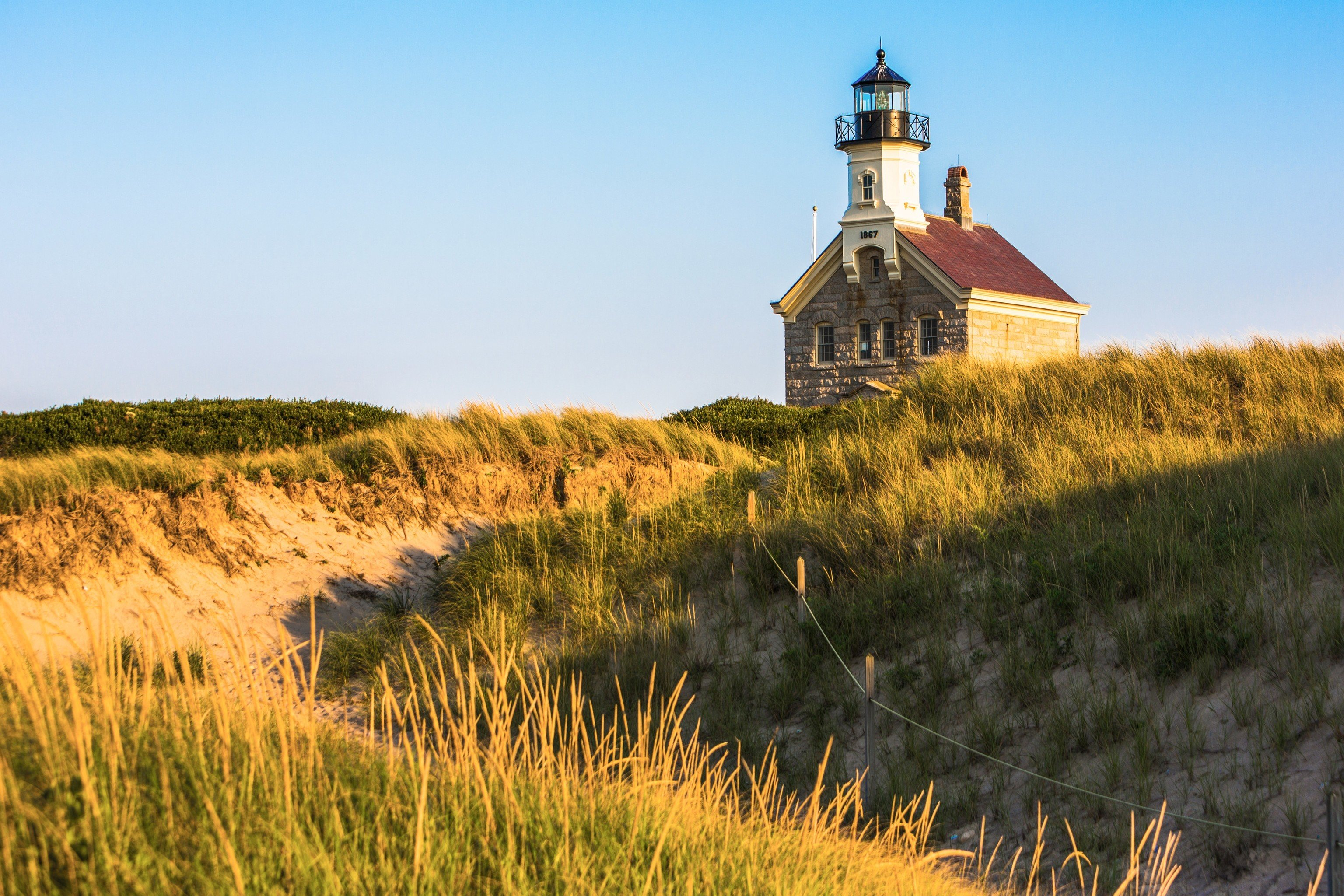 Jetsetter Guides grass outdoor sky tower lighthouse field prairie Coast hill rural area plant landscape tall grassy lush